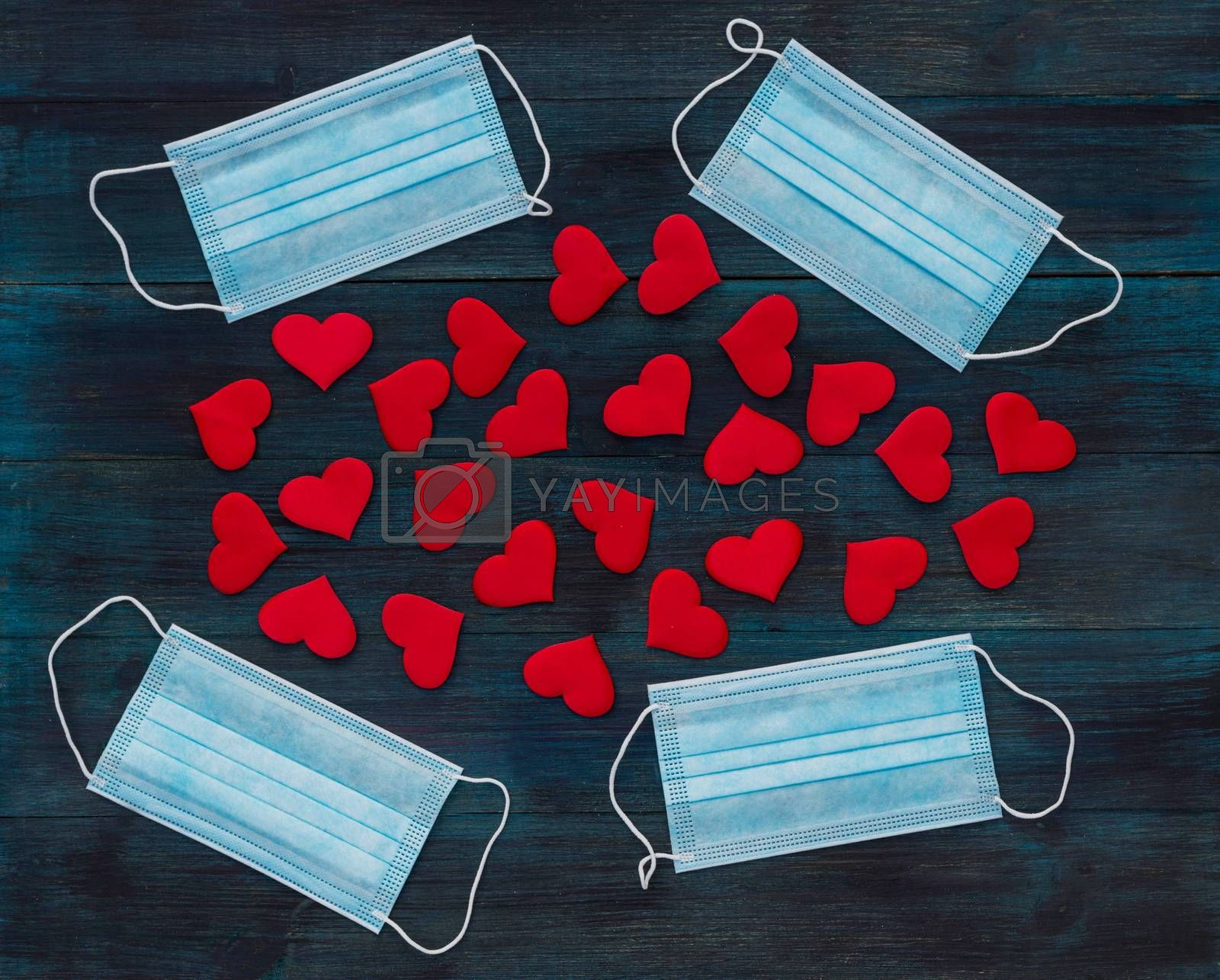 Valentine's day romantic background with medical masks symbolizing coronavirus pandemic and social distancing