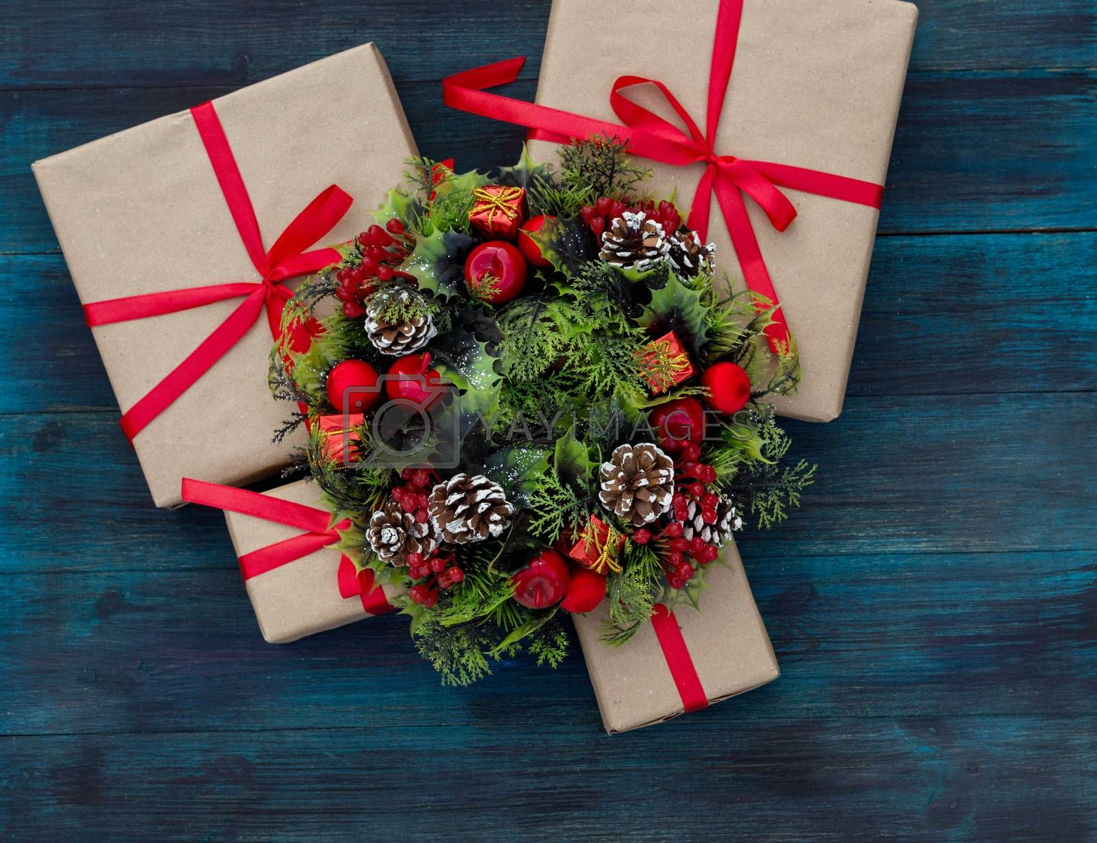 .Christmas background with gifts tied with a red ribbon and decorative wreath