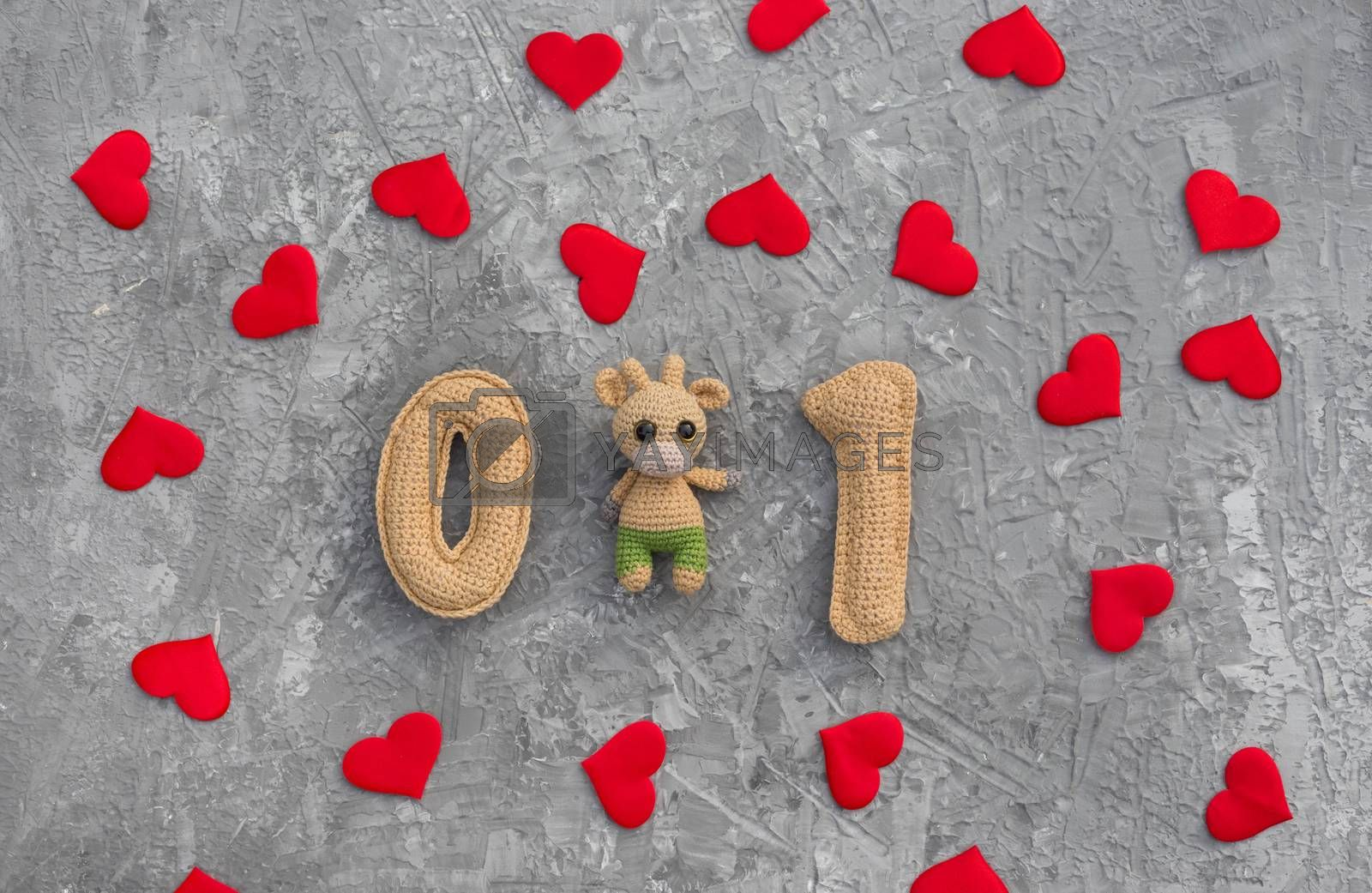 Romantic christmas background with knitted number 21 and red hearts, pandemic new year