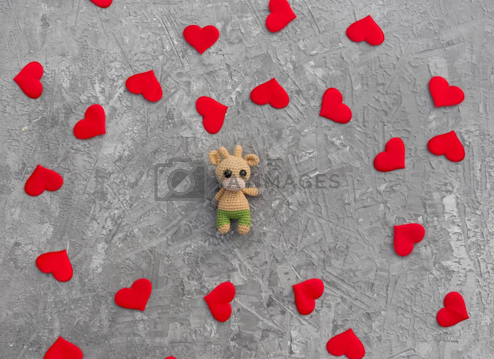 Romantic Christmas background with generic crocheted homemade toy bull symbol of the year