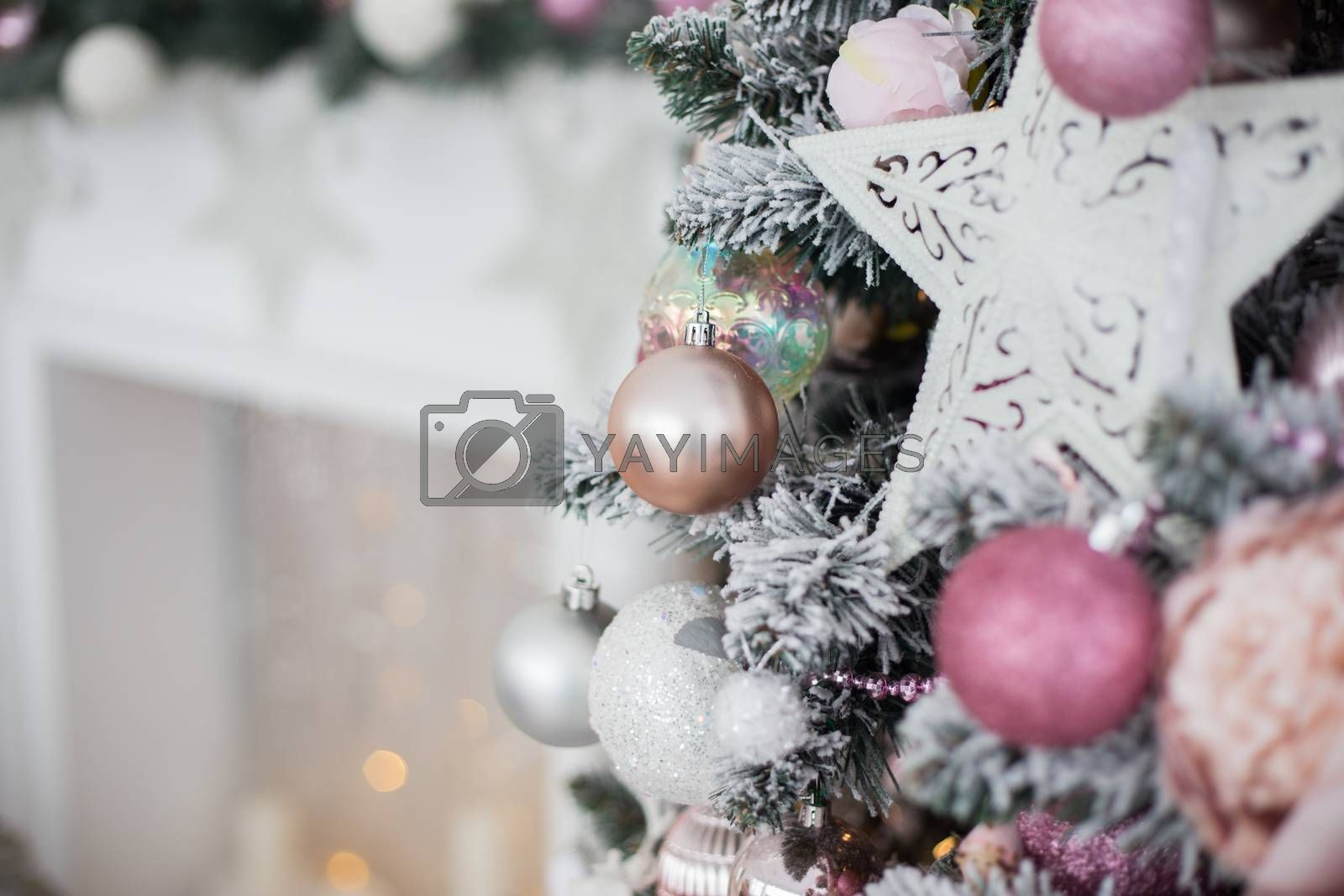 Green and White Christmas tree with pink toys new year winter gifts decor.