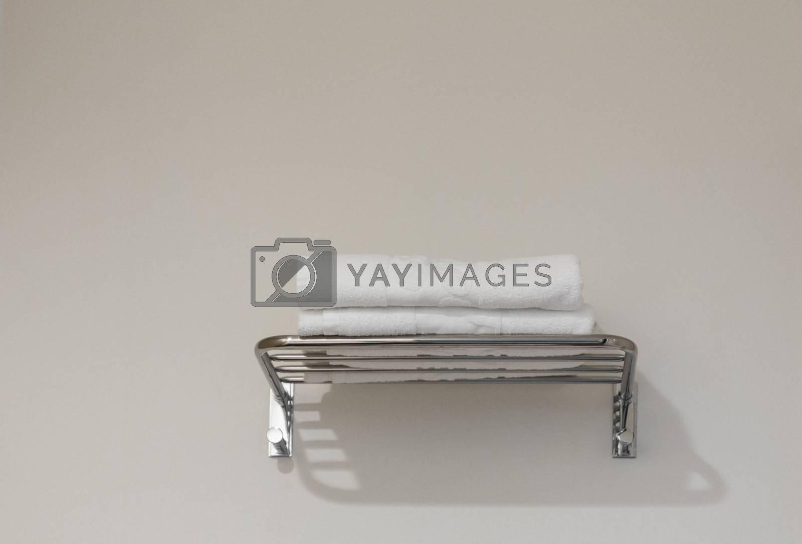 Clean towel on rack in hotel bathroom