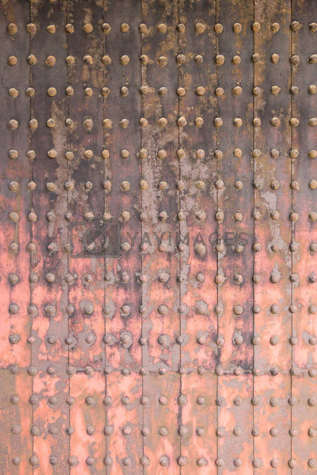 Old grunge metal wall in an old temple