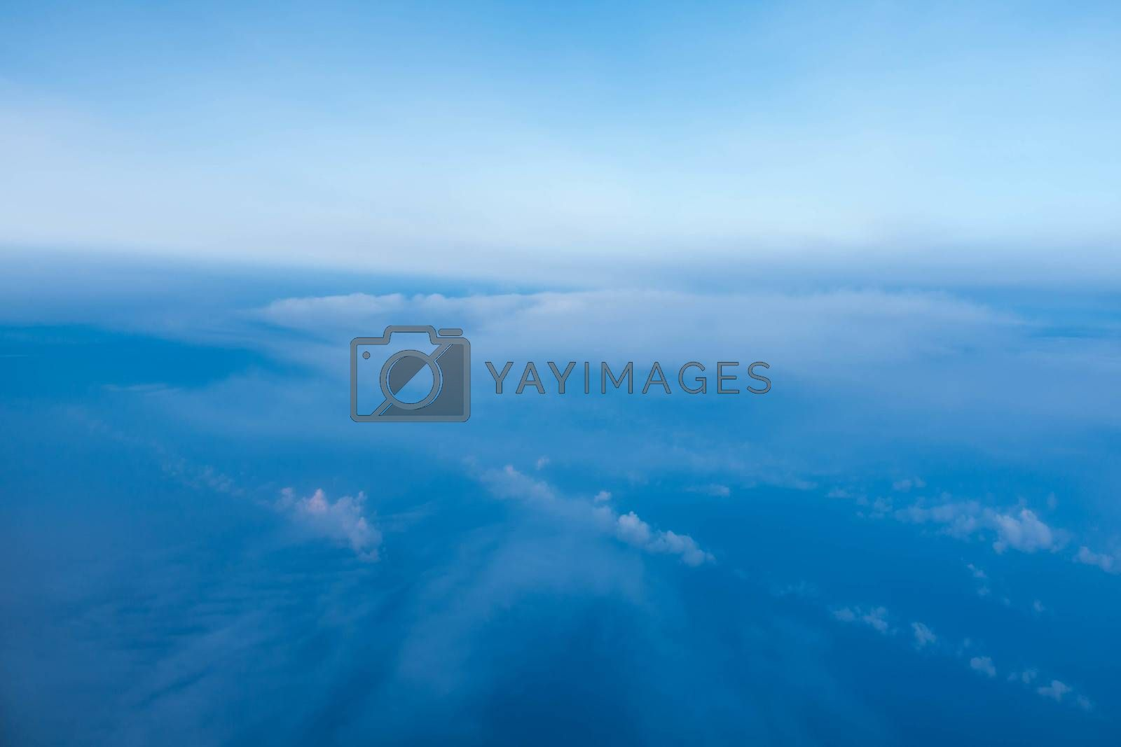 Cloud and blue sky from the airplane window