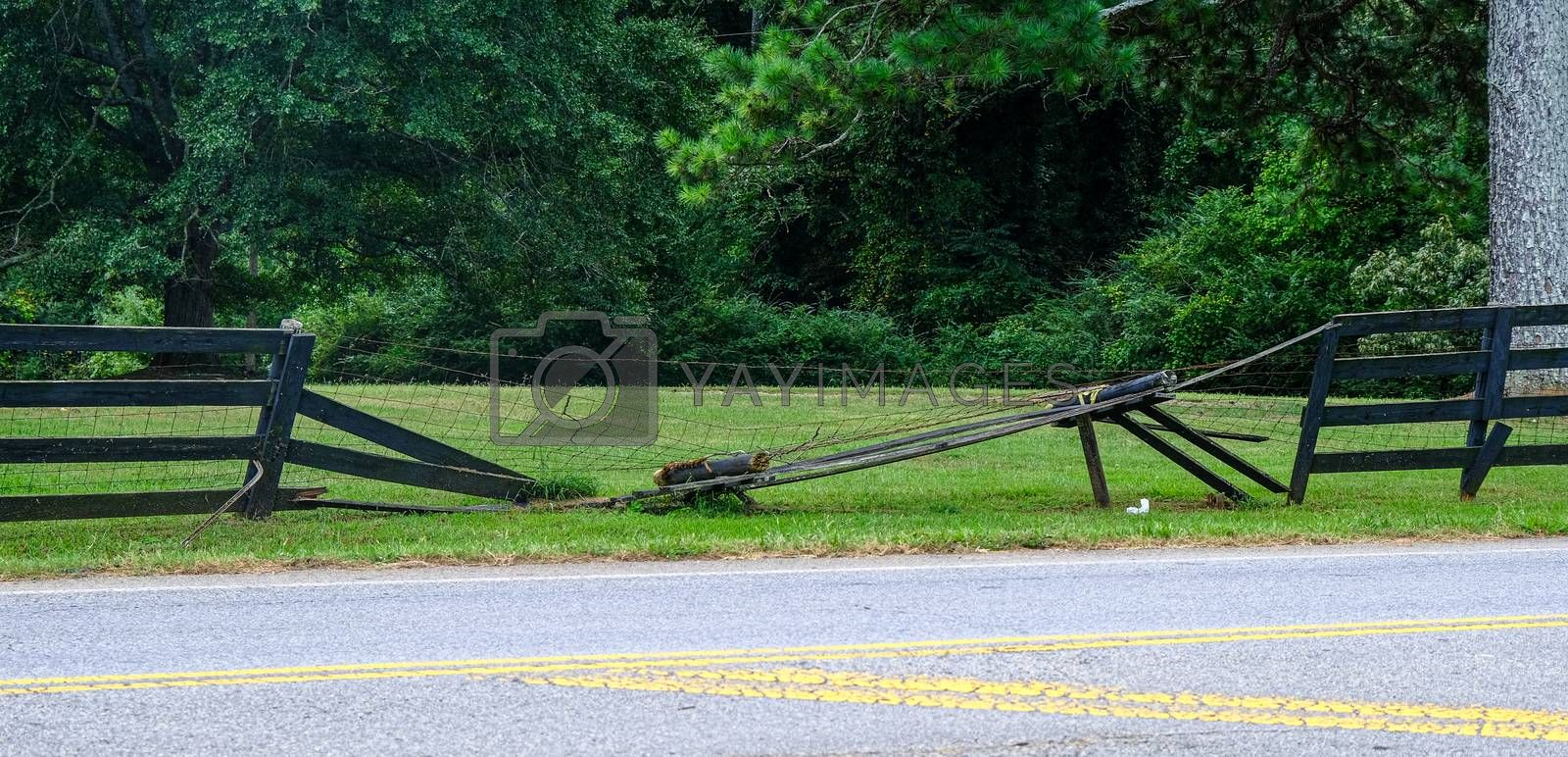 A Broken Fence by Roadside from a Car Accident