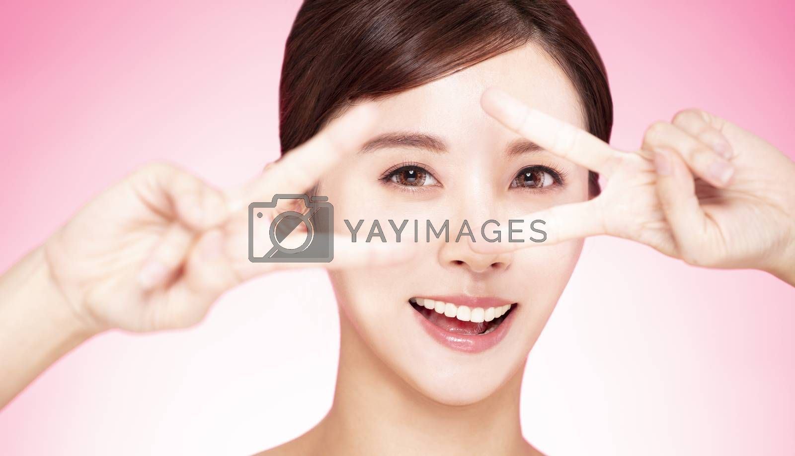 closeup cute lovely  girl face and hand with looking gesture