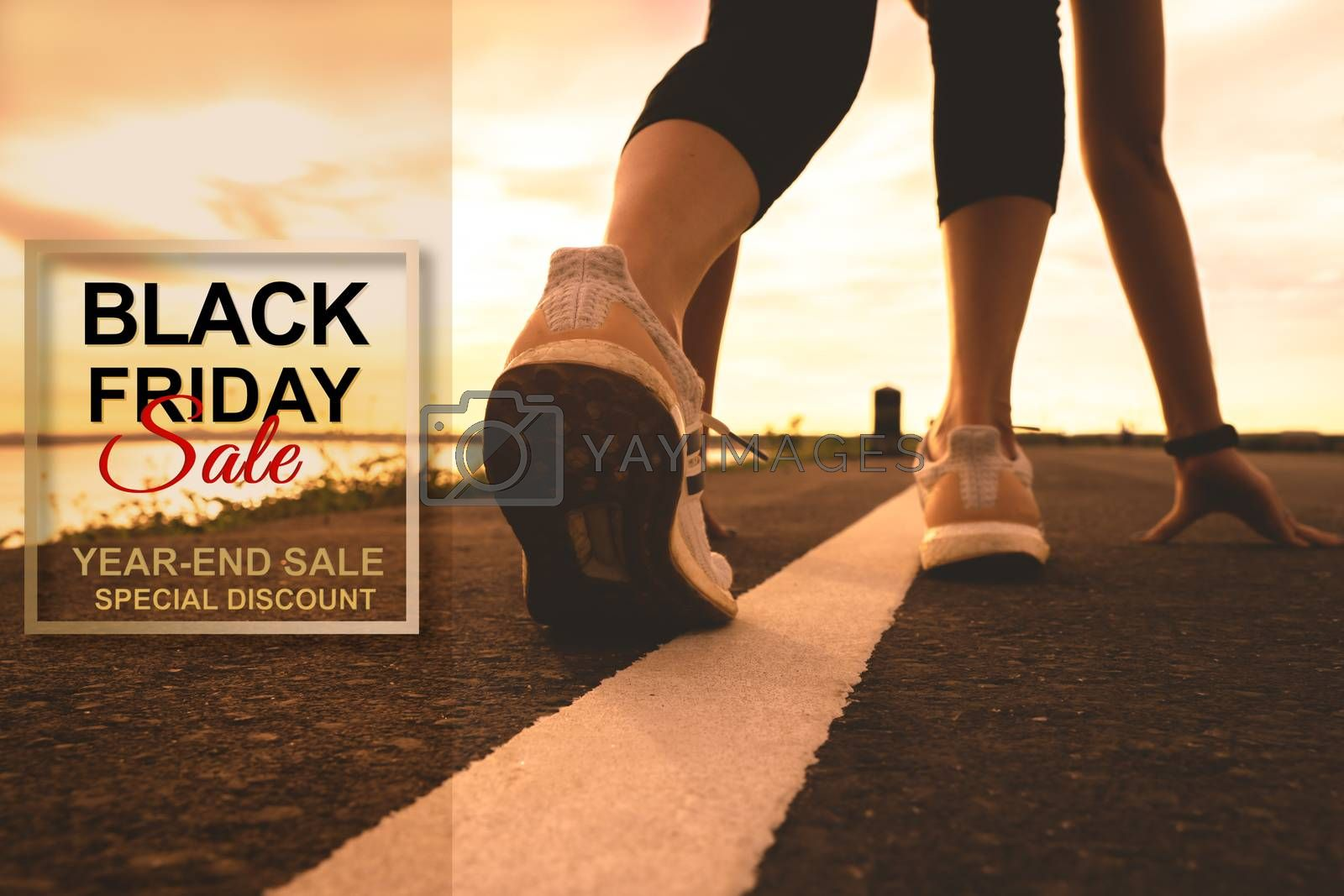 Black Friday Sale, sport runner start running on sunset - focus on shoe