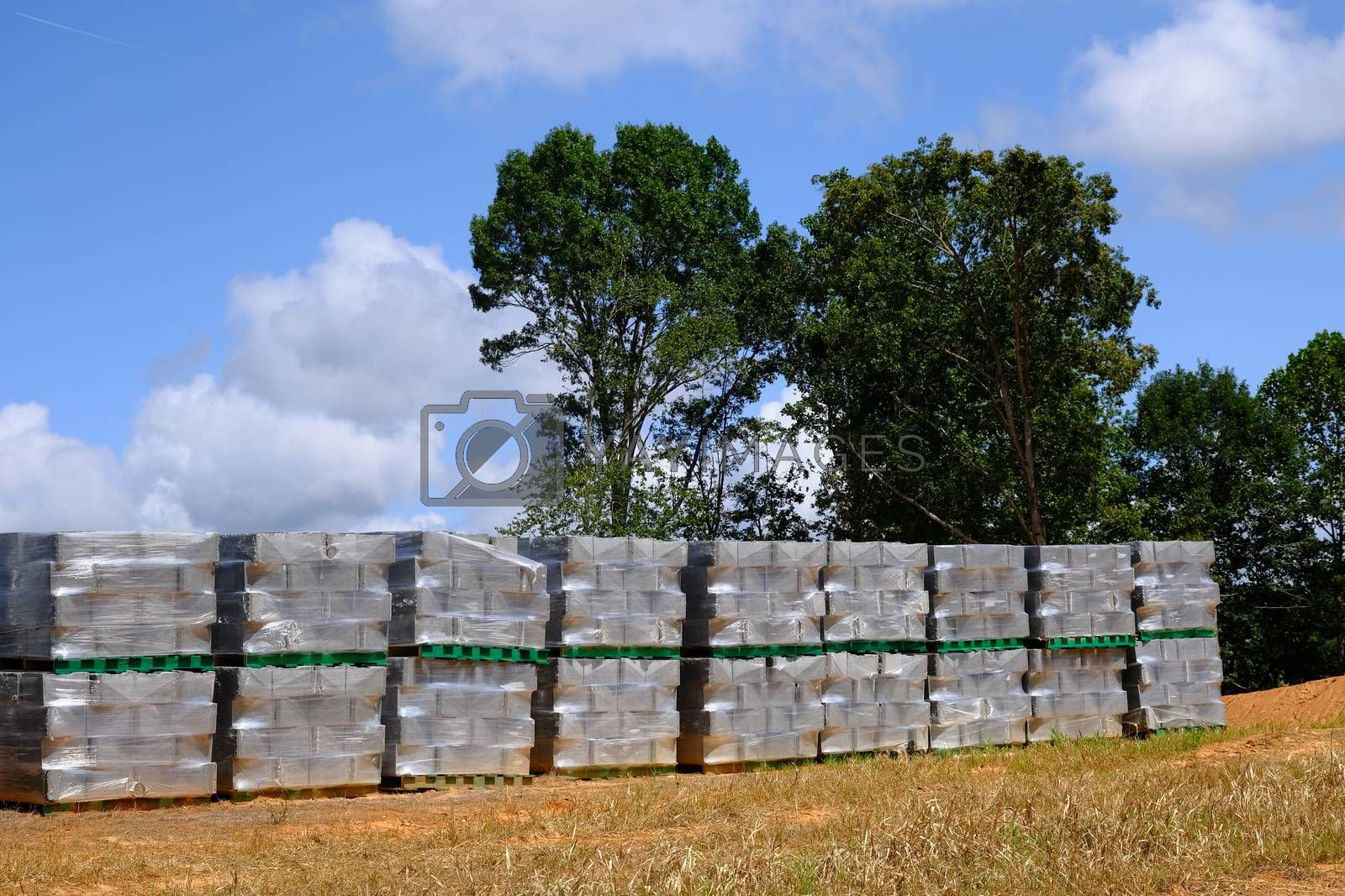 Construction Blocks Wrapped in Plastic at a Residential Construction Site