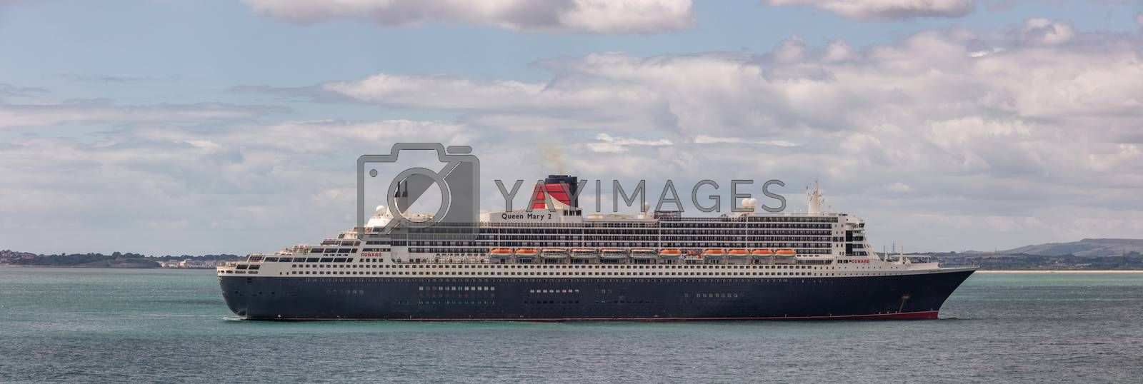 Weymouth Bay, United Kingdom - July 6, 2020: Beautiful panoramic shot of Cunard cruise ship Queen Mary 2 anchored in Weymouth Bay.