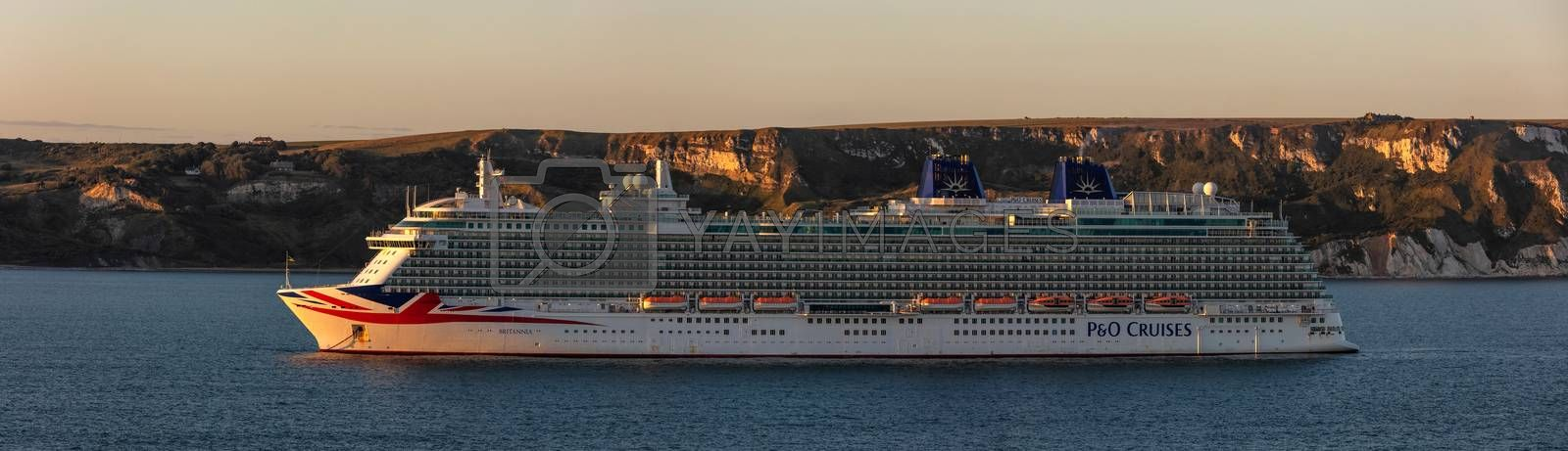 Weymouth Bay, United Kingdom - July 6, 2020: Beautiful panoramic shot of P&O cruise ship Britannia anchored in Weymouth Bay at sunset