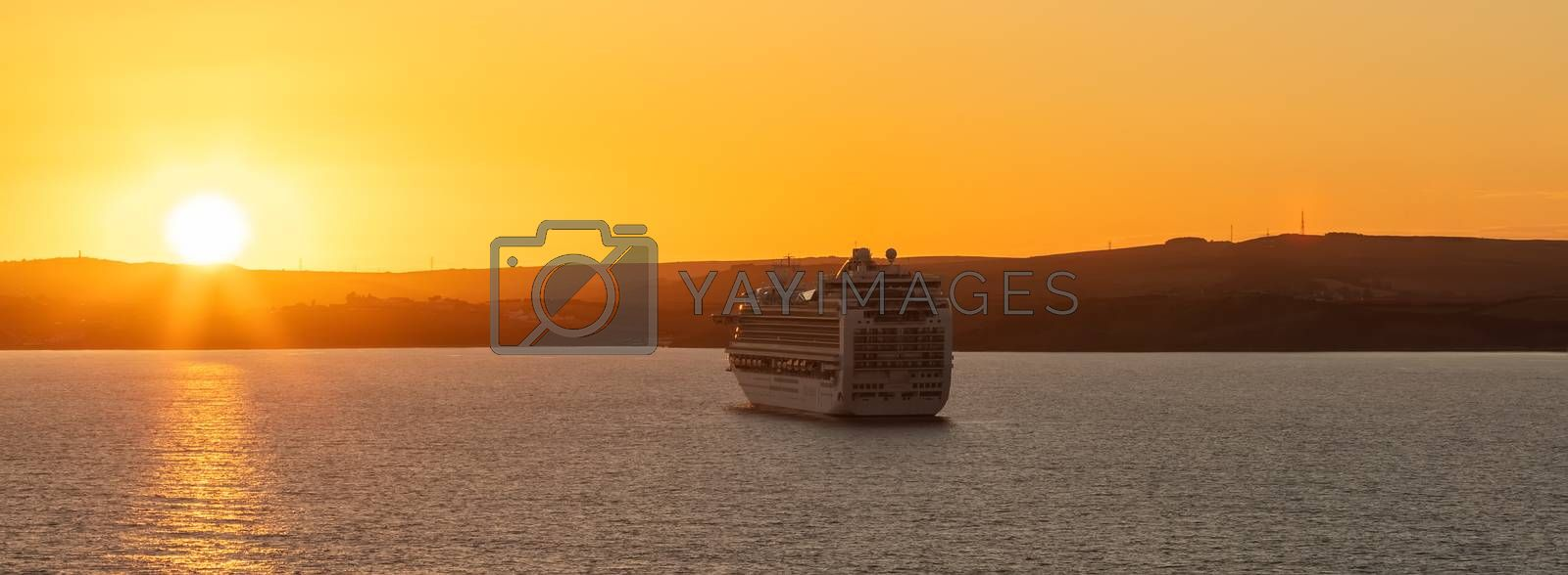 Weymouth Bay, United Kingdom - July 6, 2020: Beautiful panoramic shot of P&O cruise ship Ventura anchored in Weymouth Bay at sunset