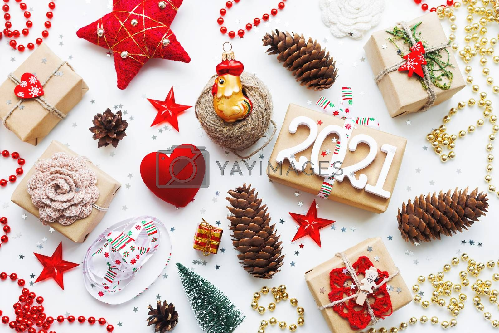 Christmas presents with decorations. New Year 2021 gifts in craf by aksenovko