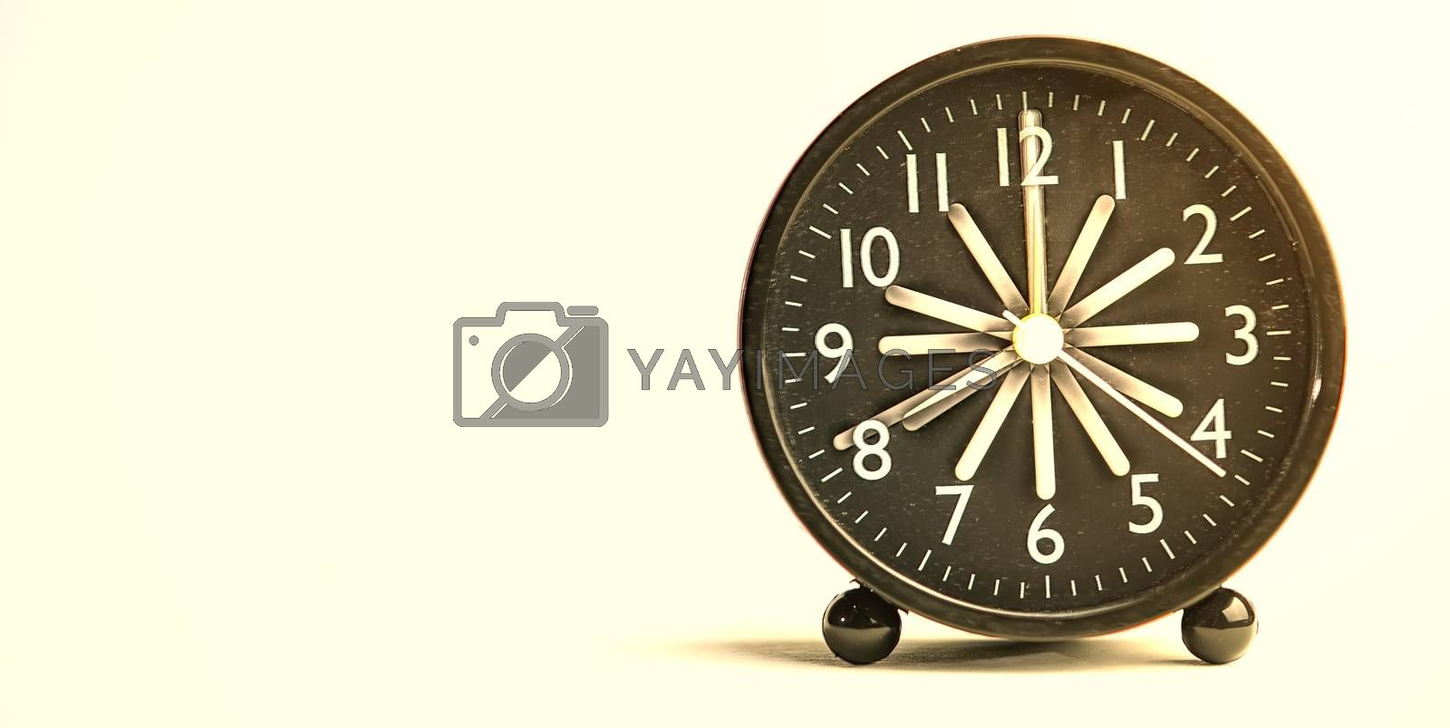 Abstract Close-up Black Analog Alarm Clock for Decoration Isolated White Background with Copy Space Radius Blur.