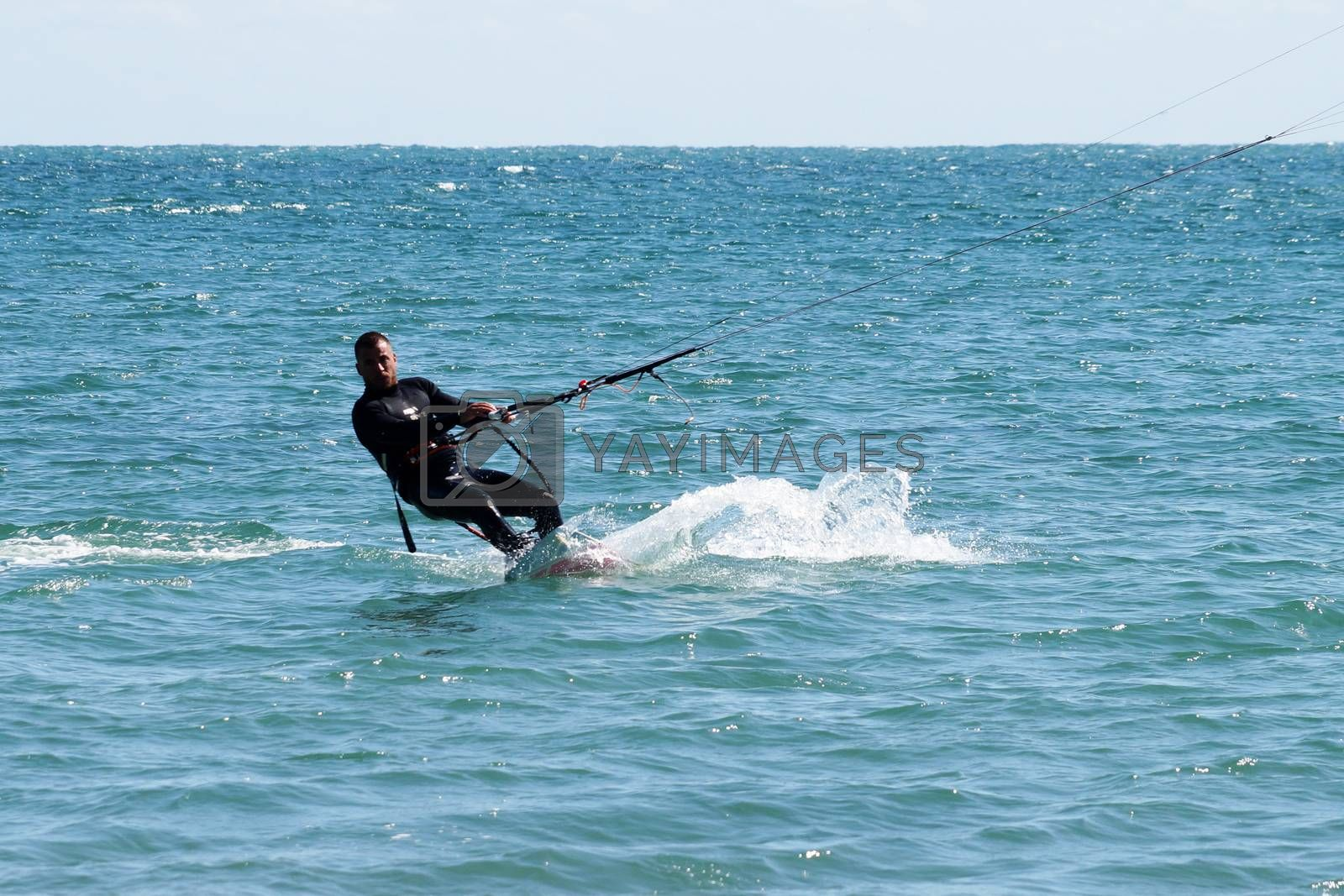 Varna, Bulgaria - September, 19, 2020: a man is kiting the sea against the background of the beachVarna