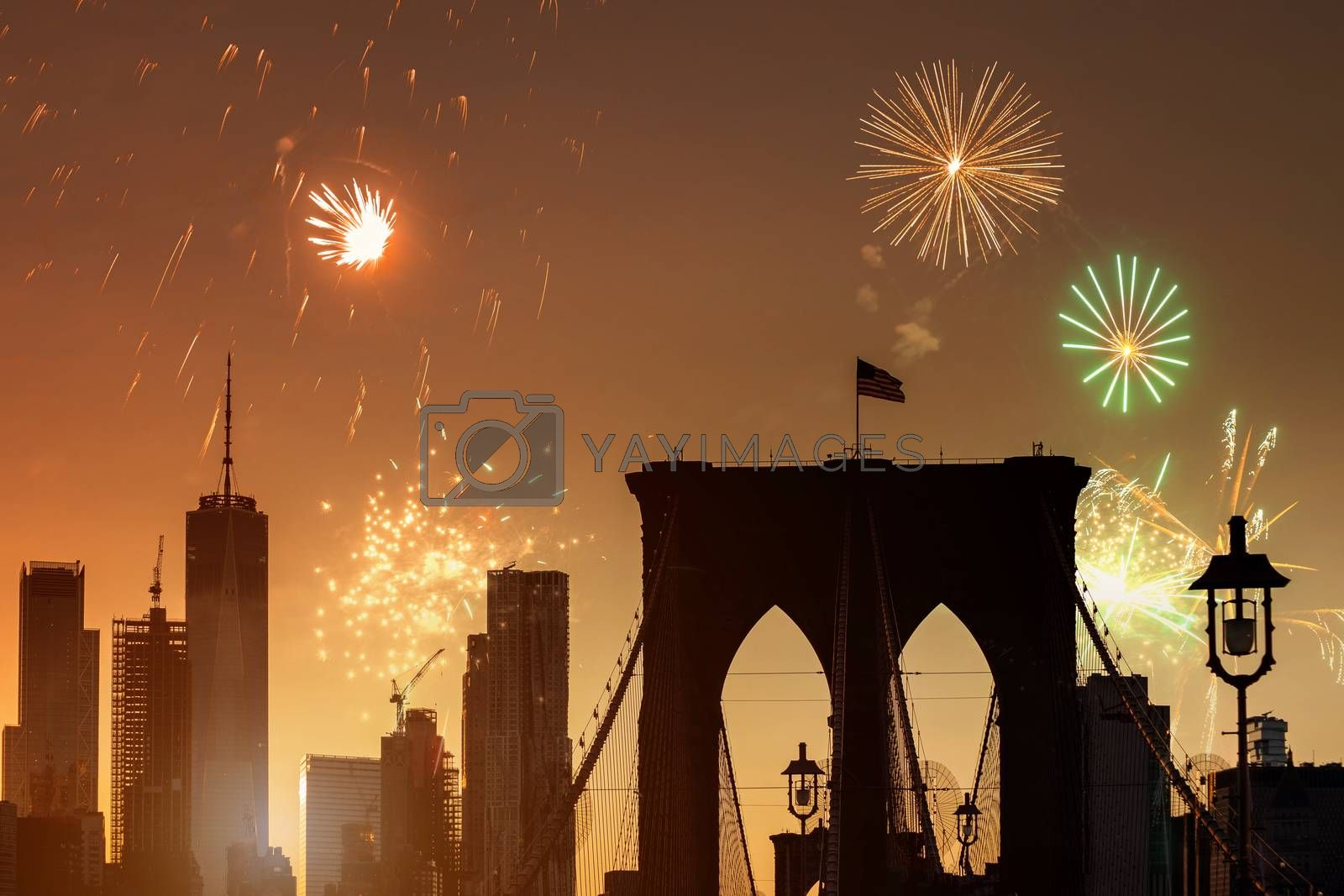 Fireworks of a salute in the New York City Manhattan beautiful sunset with brooklyn bridge