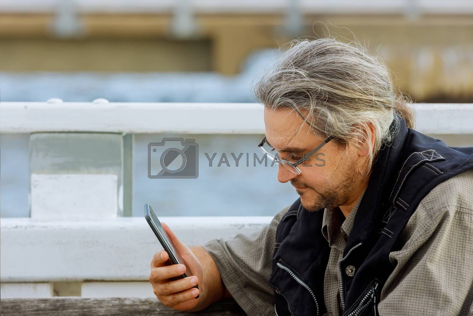Technology, communication man with smartphone on street against of the bay