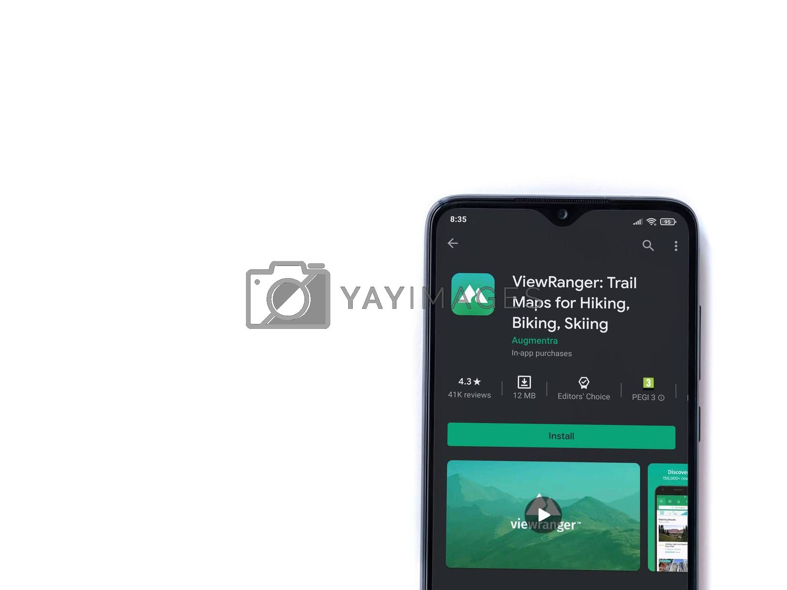 Lod, Israel - July 8, 2020: ViewRanger app play store page on the display of a black mobile smartphone isolated on white background. Top view flat lay with copy space.