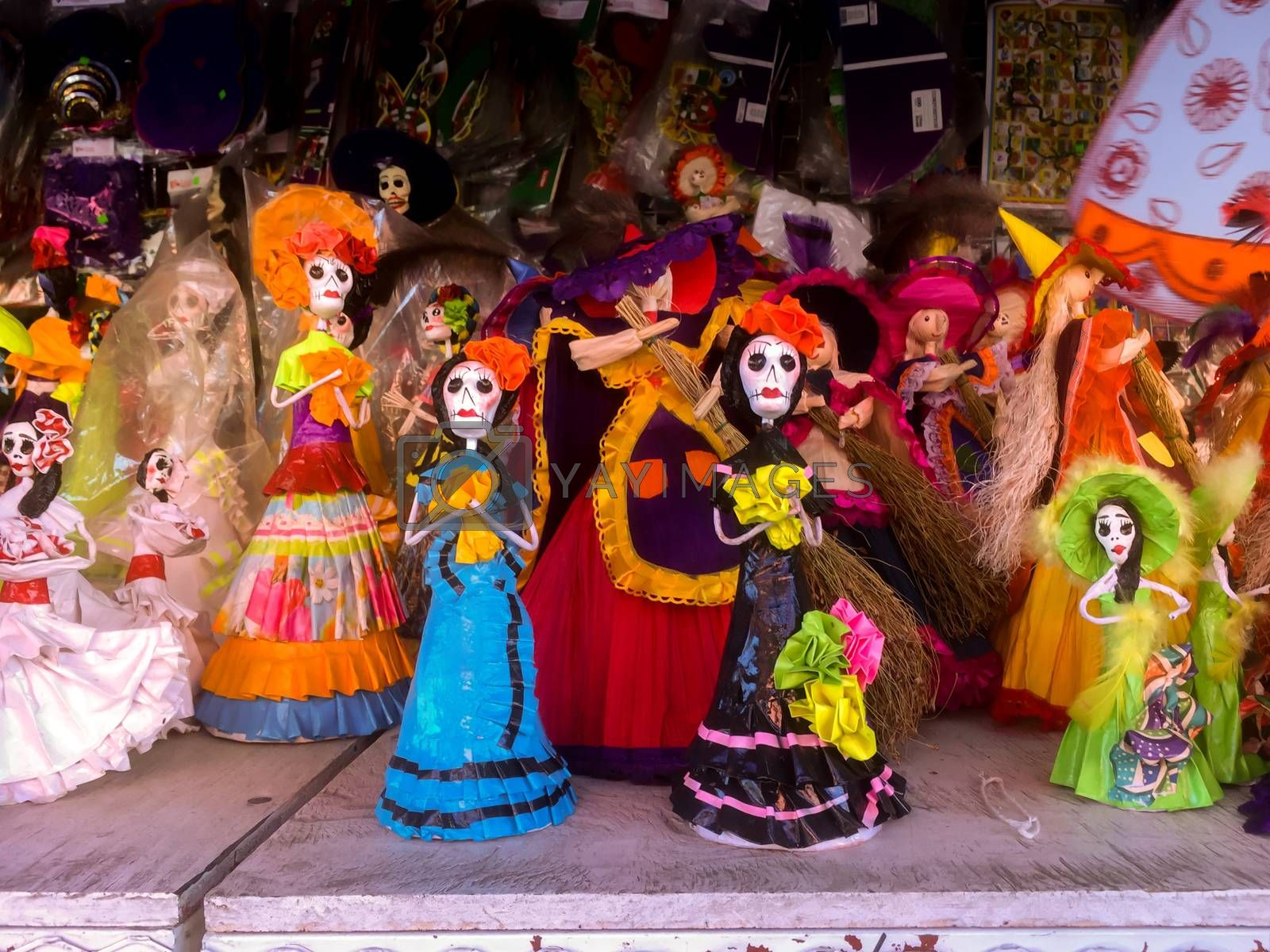 Papier mache figurines of La Catrina, evocative of Mexican culture and the Day of the Dead celebrations, make popular ornaments during the halloween and Dia de Muertos holidays