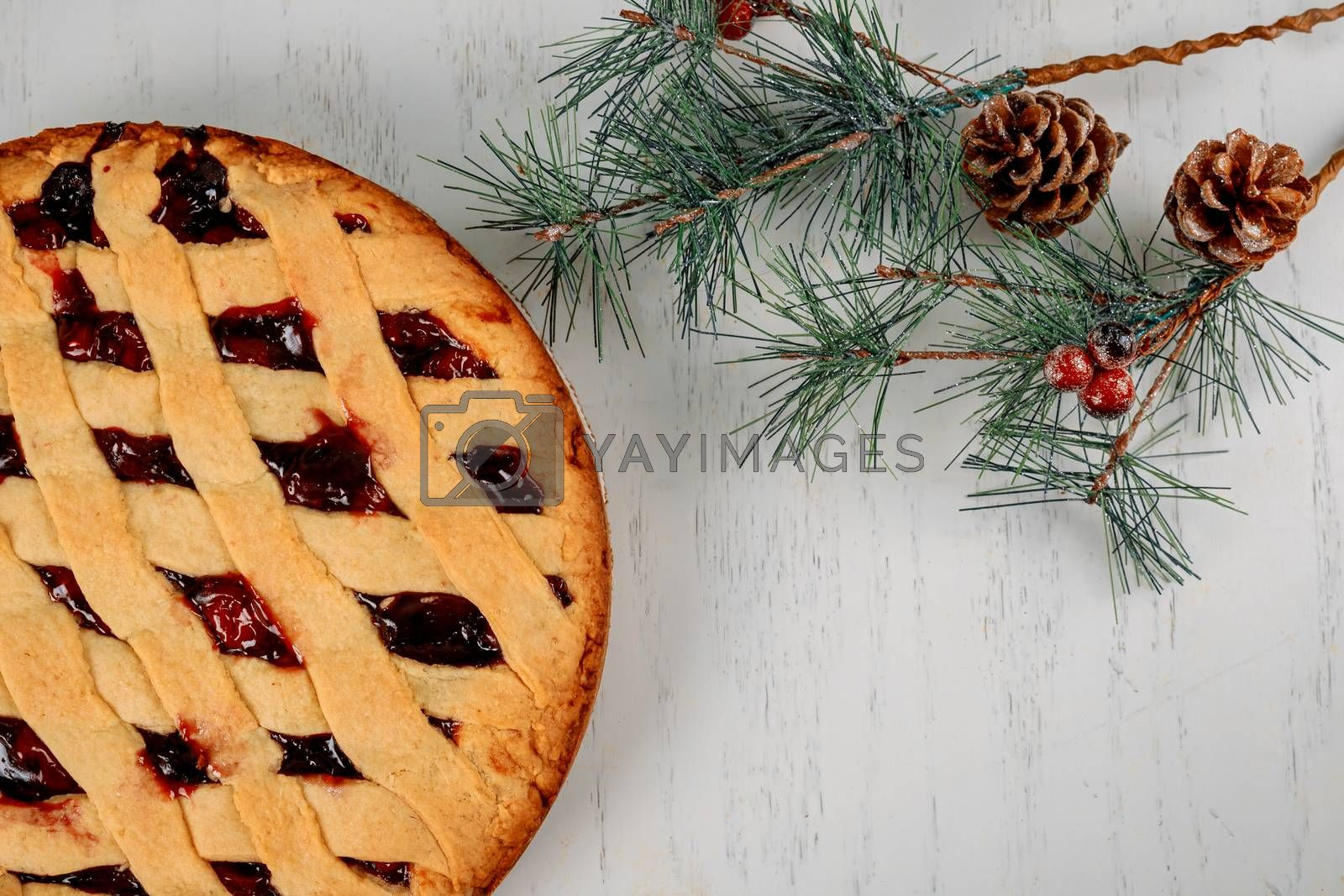 Christmas holiday with apple pie and fir tree top view flat lay on wooden table with copy space.