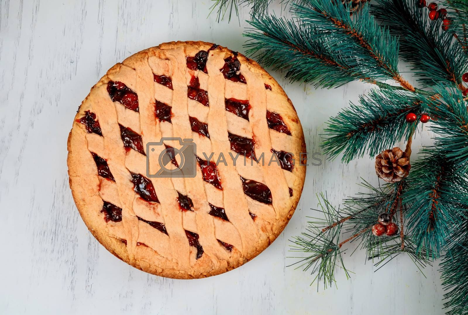 Homemade apple pie cake and chistmas decorations on a wooden background