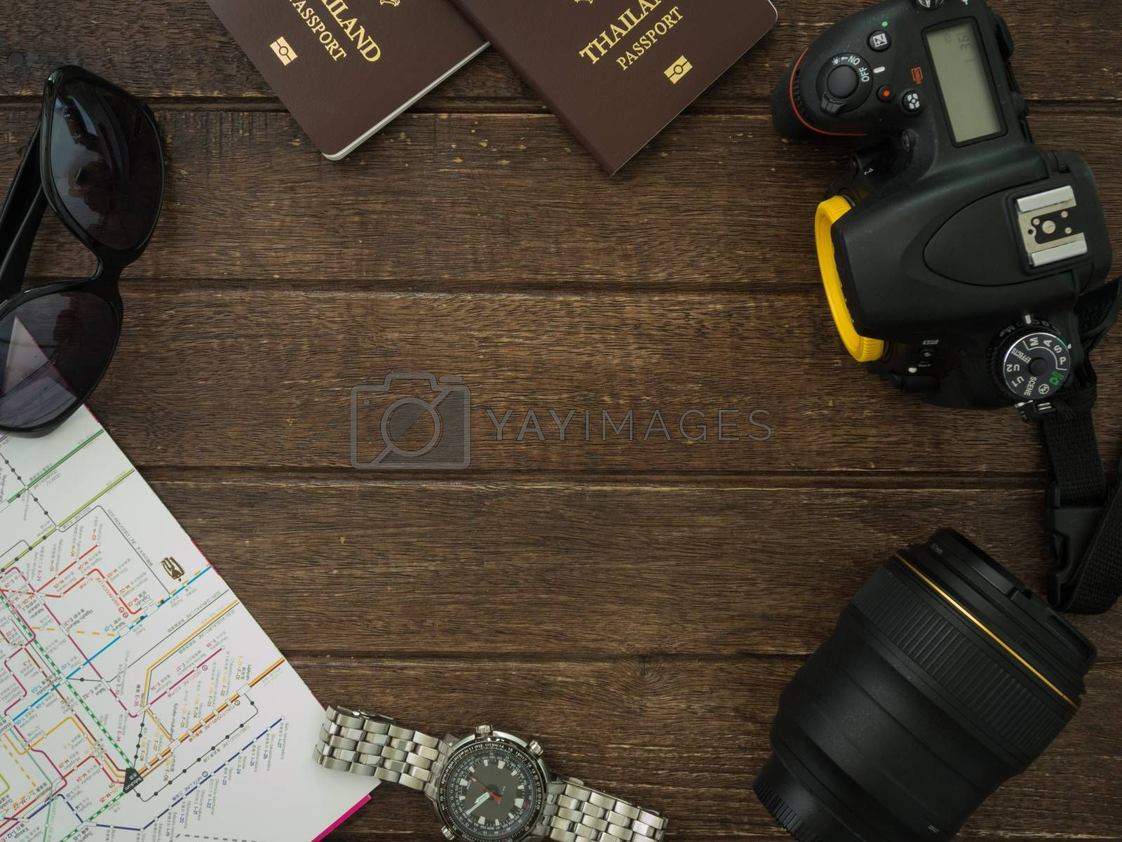 Travel Accessories on wooden table. view above