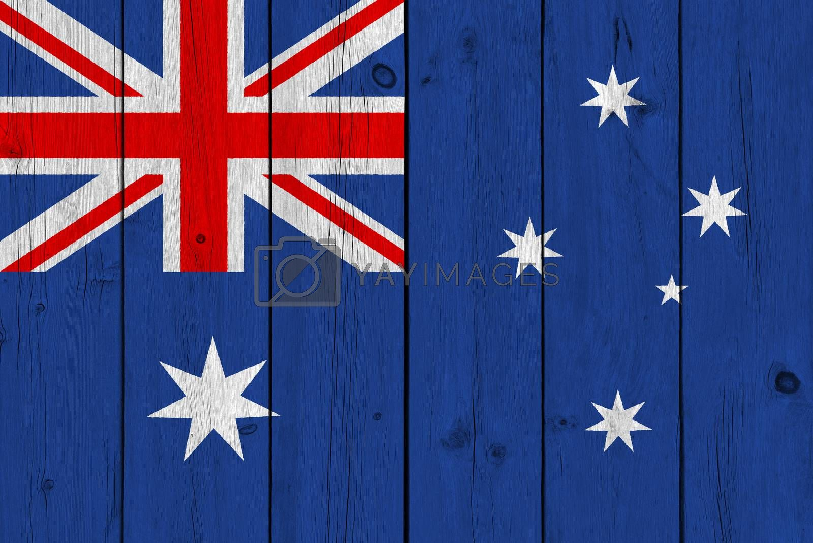 Australia flag painted on old wood plank. Patriotic background. National flag of Australia