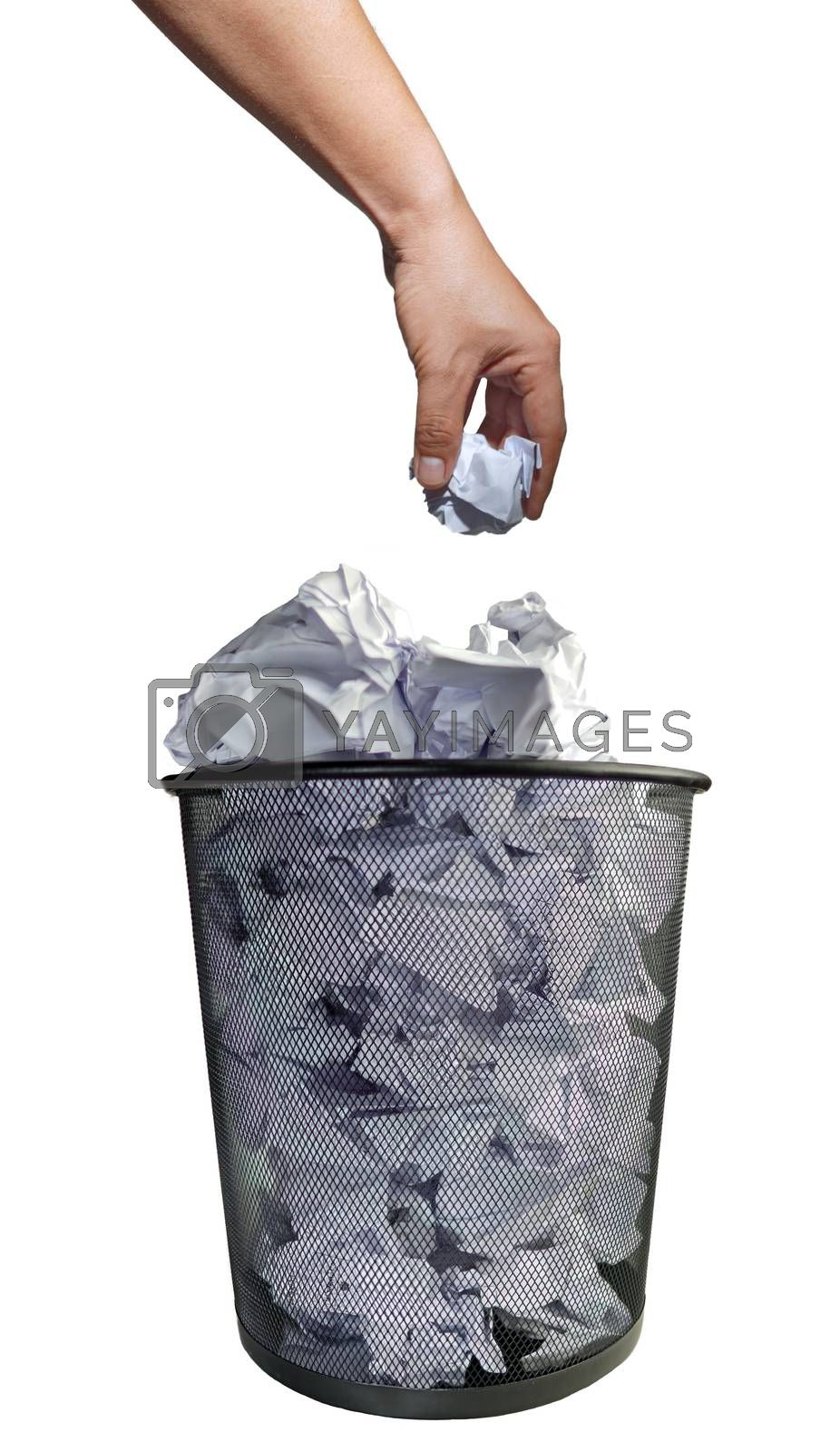 Abstract environmental protection hand throwing office used paper scraps into black metal trash isolated white background.