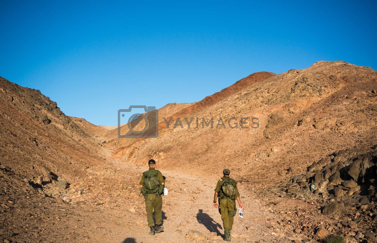 Soldiers patrol in desert by javax