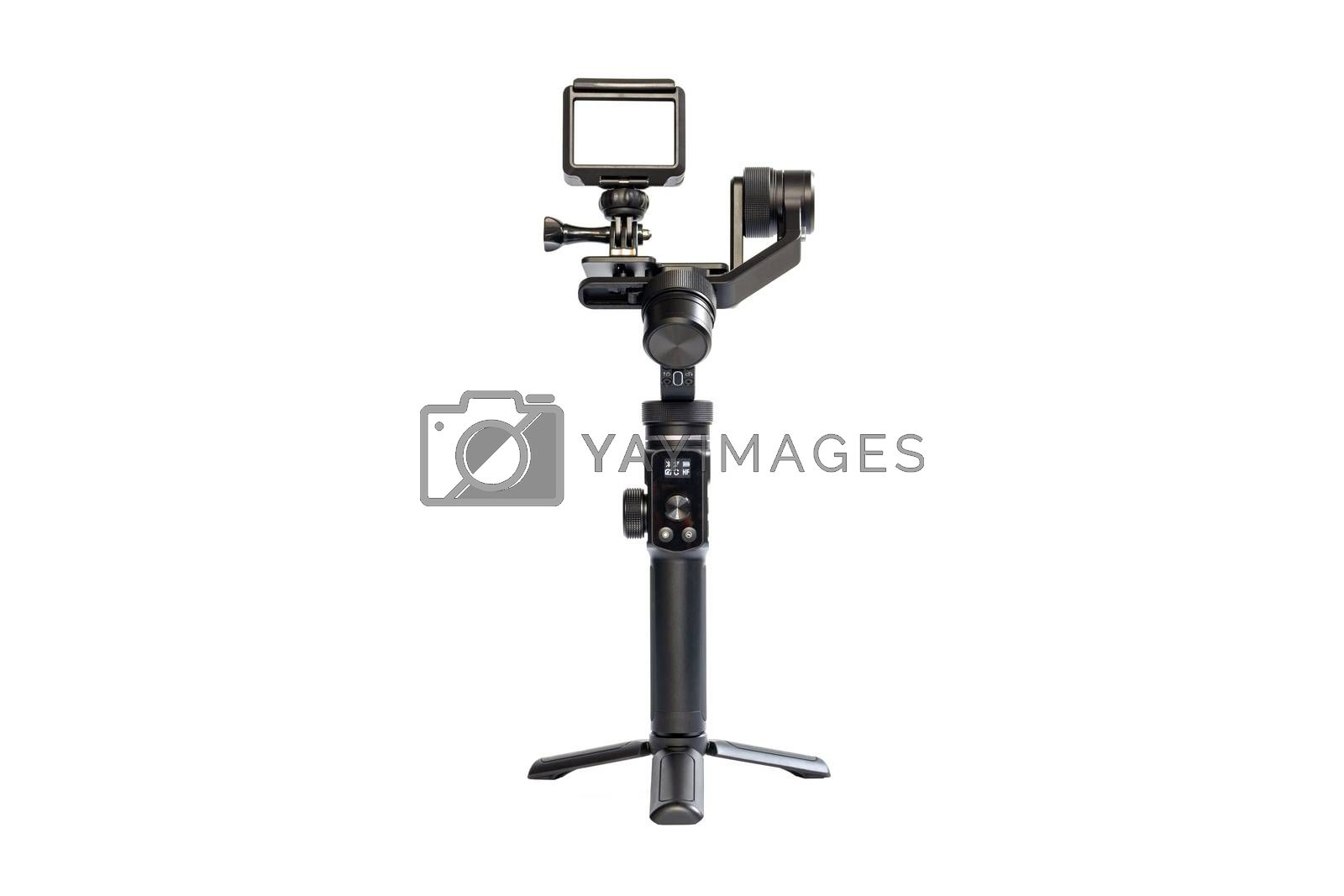 Action camera is mounted on a 3-axis motor stabilizer for smooth video recording isolated on white background.