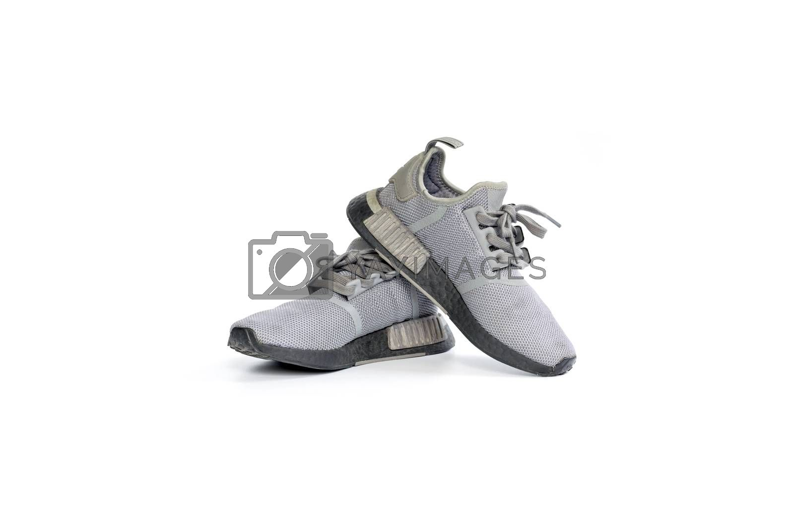 Pair of gray running shoes isolated on white background.