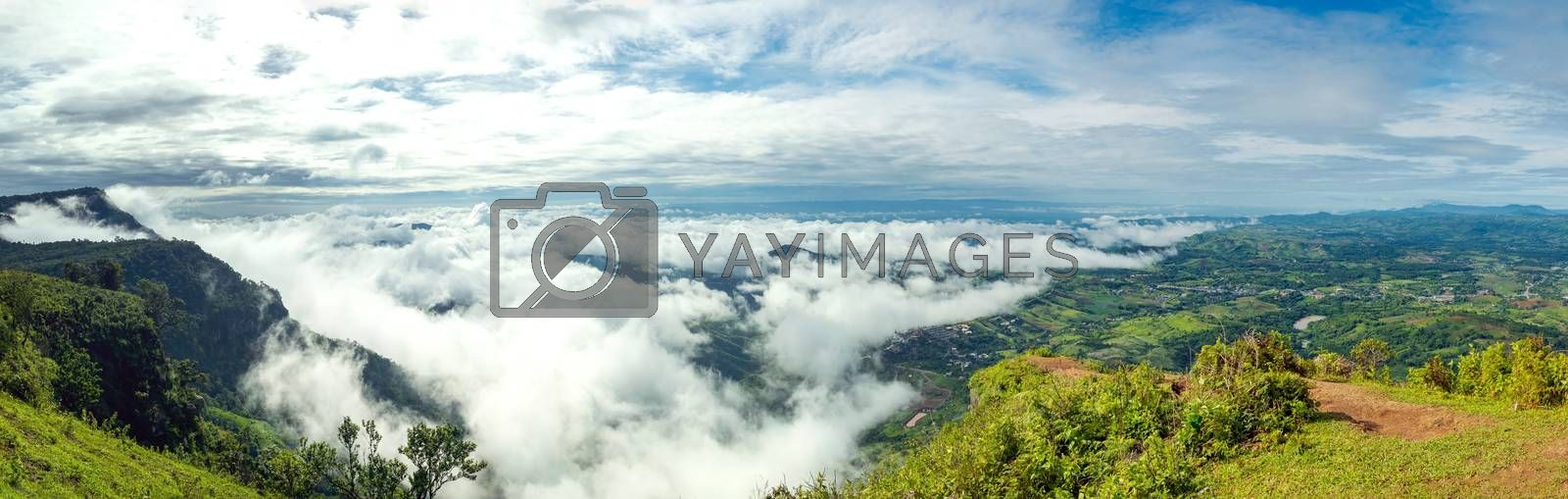 Panoramic view of the clouds covering the city taken from the highest point at the top of the mountain in Thailand.