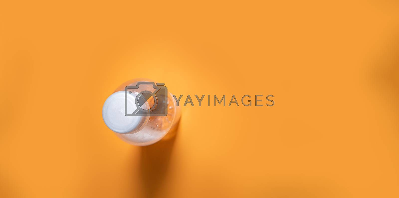 water bottle on orange background with copy space
