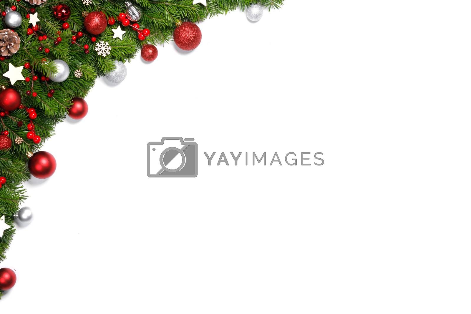Christmas tree branches and decoration baubles isolated on white background as a border or template for christmas card