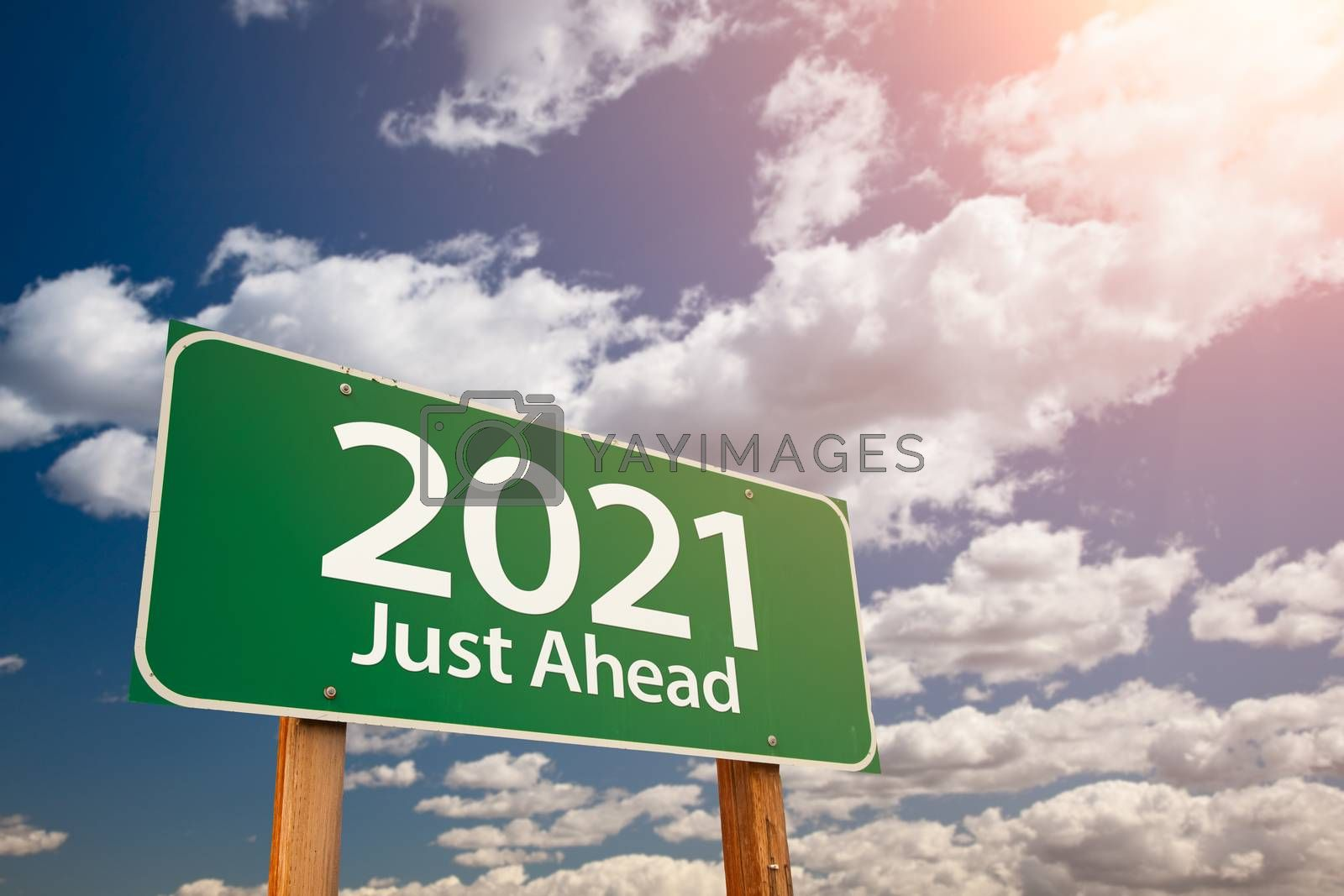 2021 Green Road Sign Over Dramatic Clouds and Sky by Feverpitched