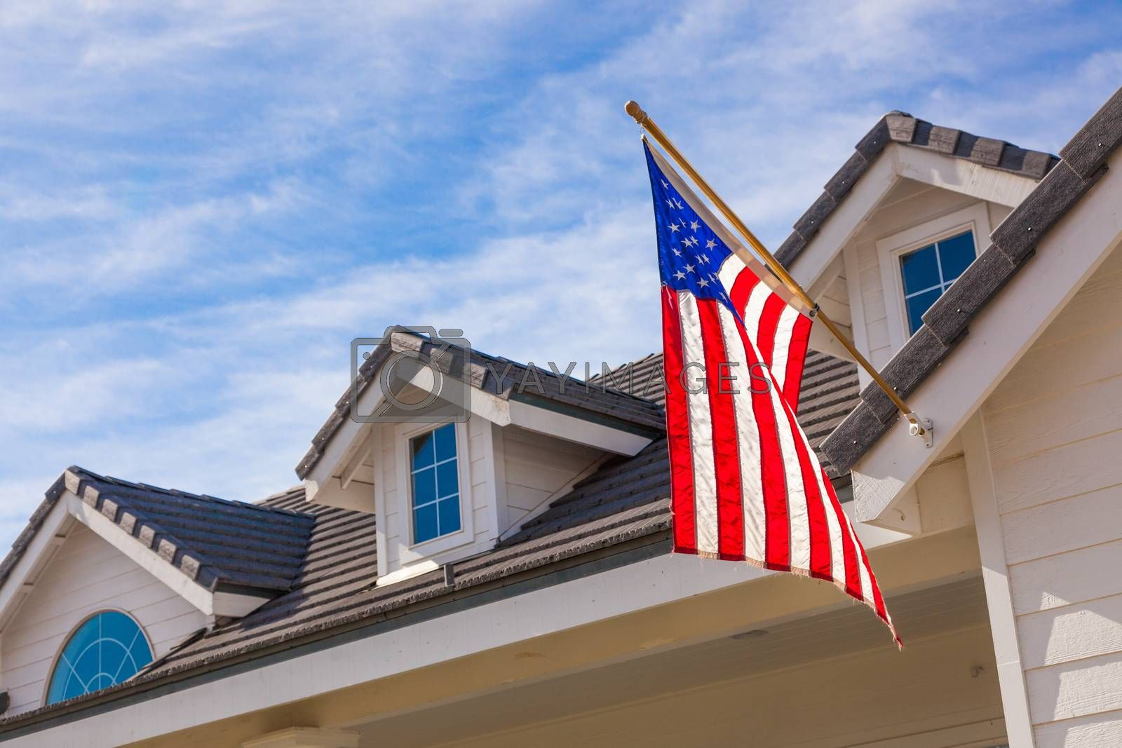 American Flag Hanging From House Facade by Feverpitched