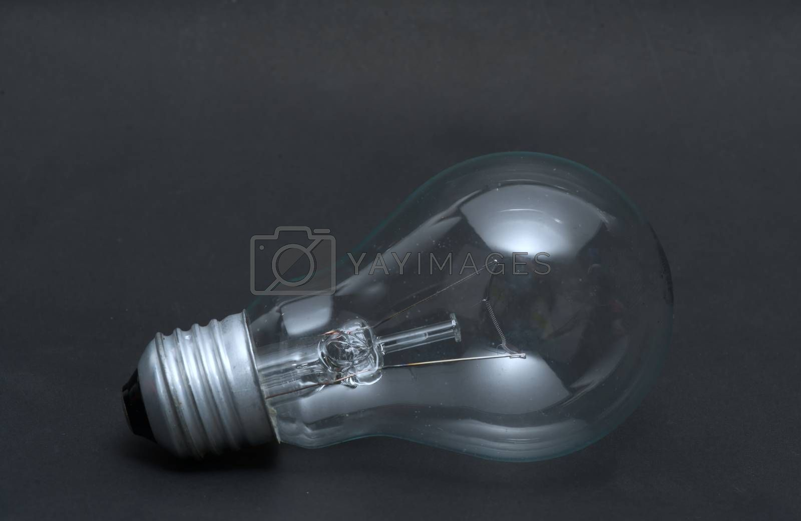 Abstract previously used light bulb concept on black isolated background.