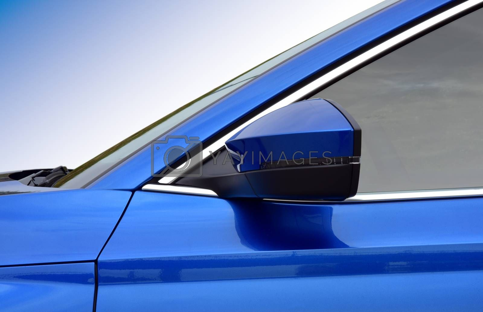 Royalty free image of Side mirror with turn signal of a car by aselsa