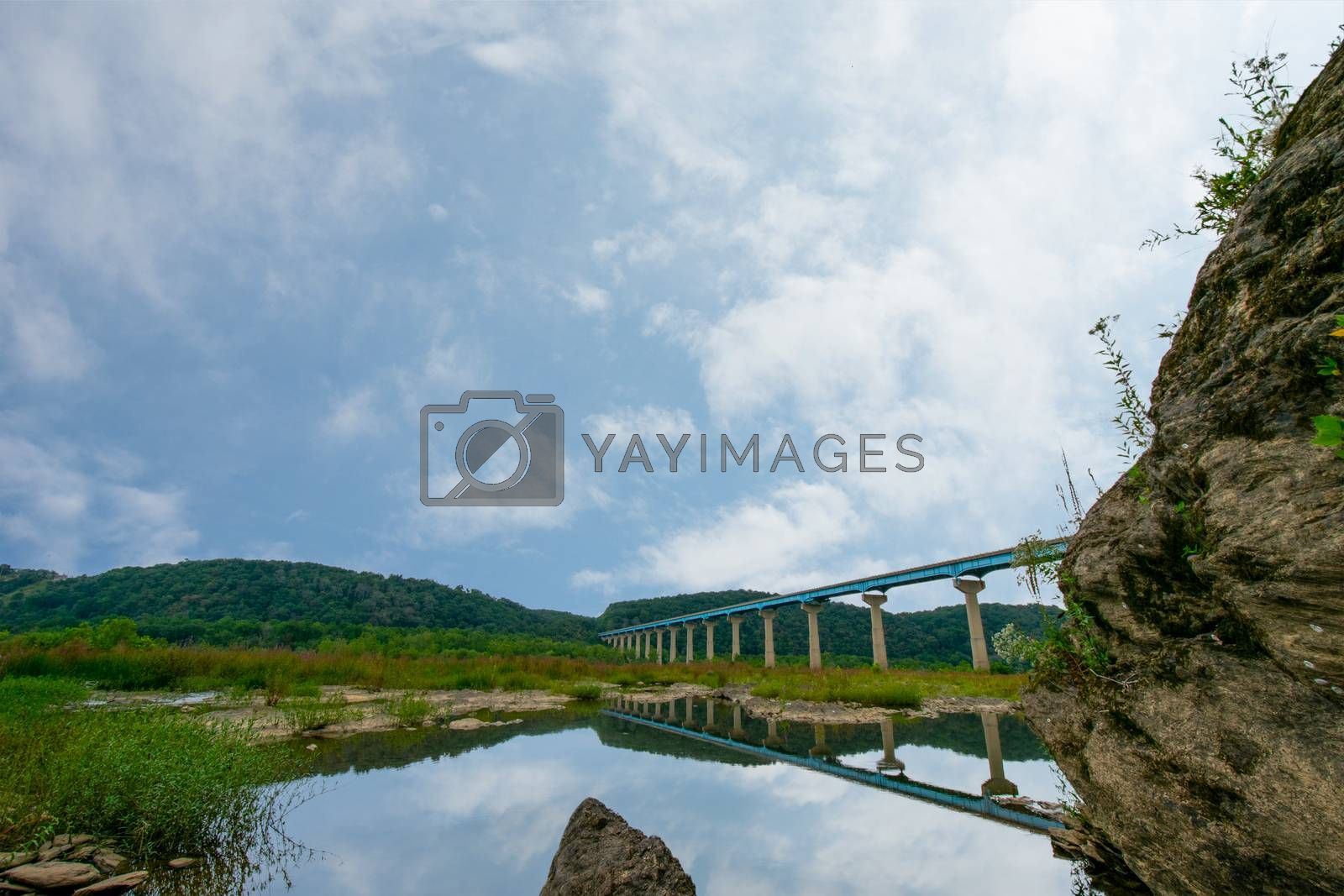 The Norman Wood Bridge Over the Susquehanna River in Holtwood Pennsylvania Casting a Reflection Into the Water