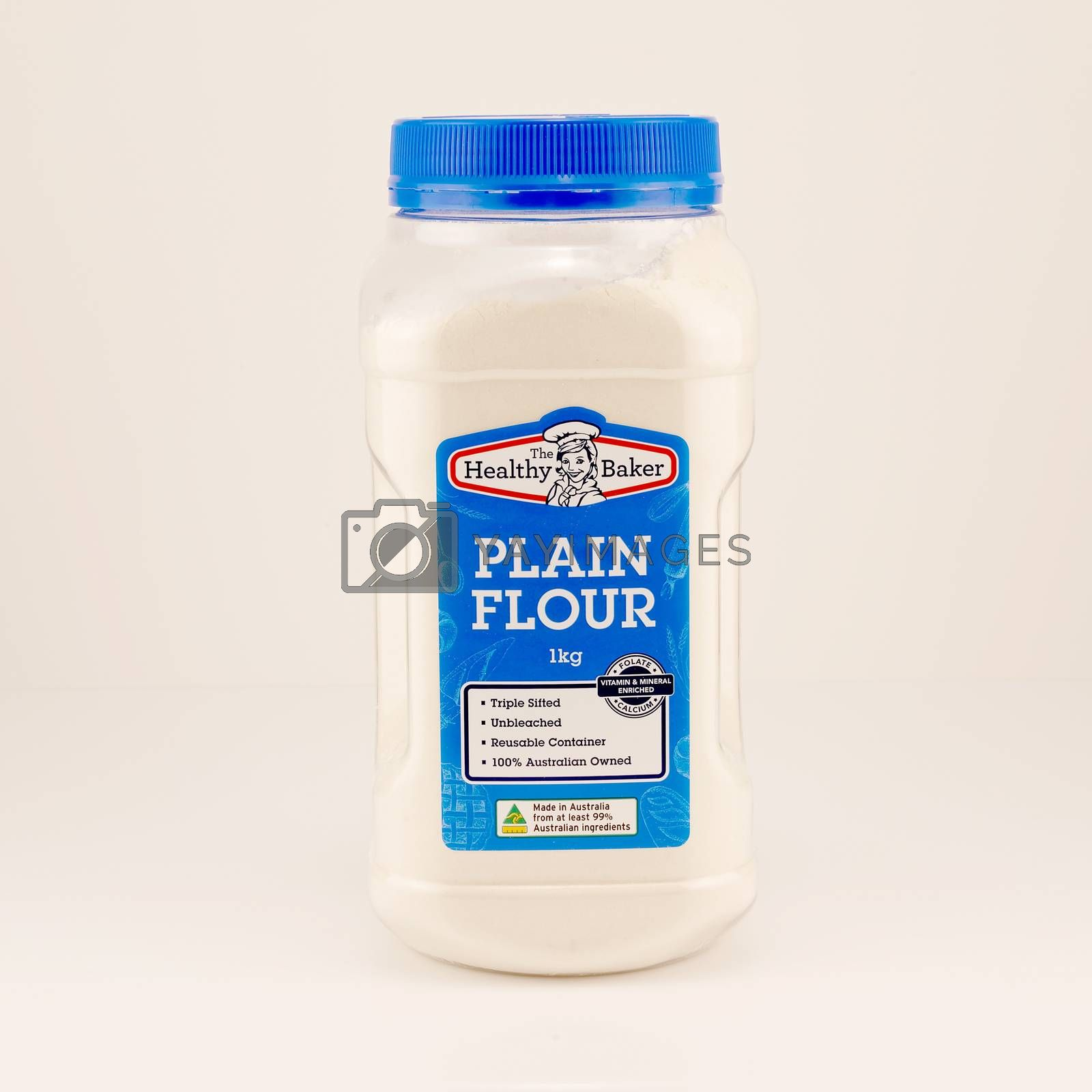 Mackay, Queensland, Australia - February 2020: Bottle of plain flour isolated on a white background, product photography
