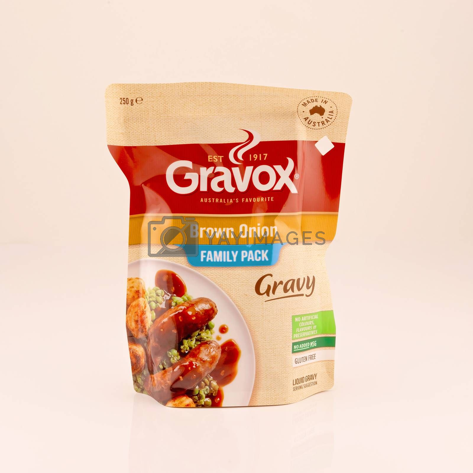 Mackay, Queensland, Australia - February 2020: A packet of ready made gravy isolated on a white background, product photography