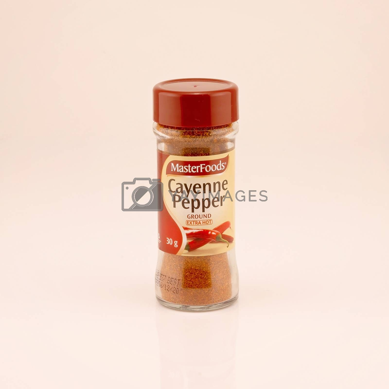 Mackay, Queensland, Australia - February 2020: A bottle of cayenne pepper isolated on a white background, product photography