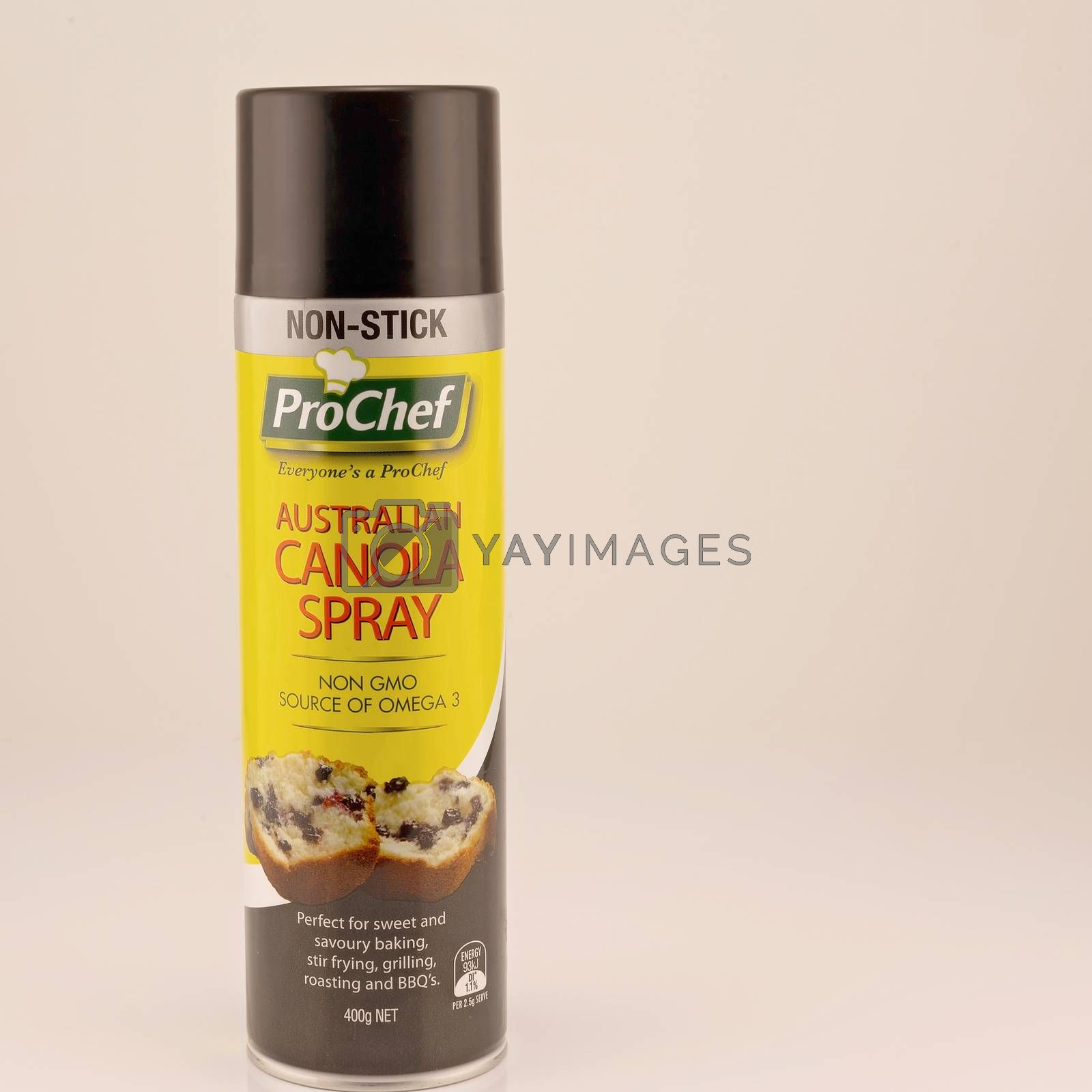 Mackay, Queensland, Australia - February 2020: A can of canola cooking oil spray isolated on a white background, product photography
