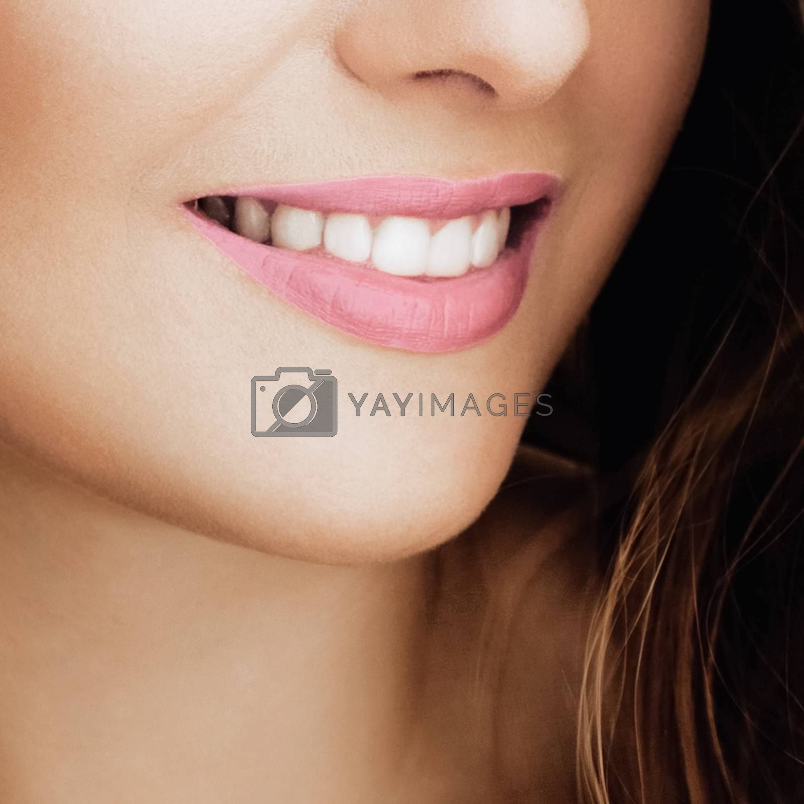 Beautiful healthy female smile with perfect natural white teeth, beauty face closeup of smiling young woman, bright lipstick makeup and clean skin for dental and healthcare brands