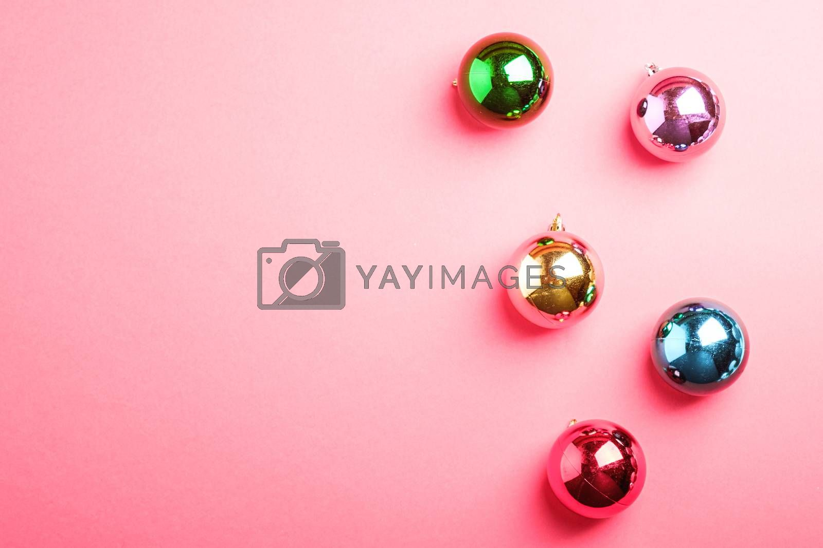 Christmas New Year composition. Gifts, colorful ball decorations on pink background. Winter holidays concept. Flat lay, top view, copy space
