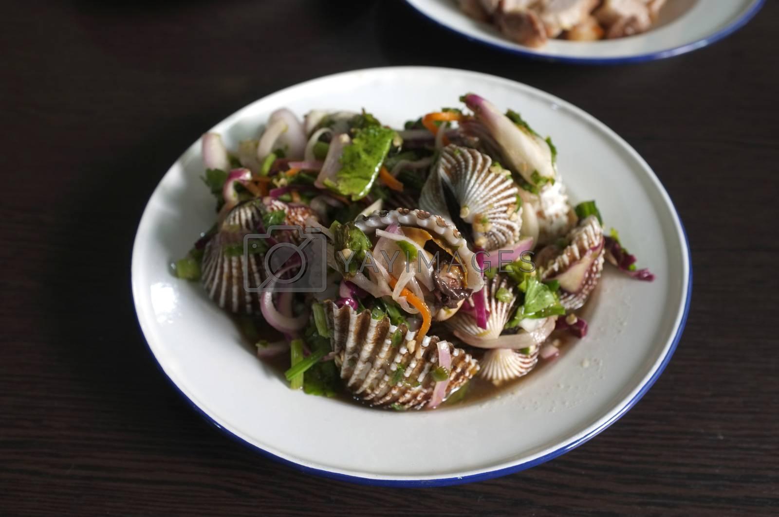 Thai street food , Spicy blood cockle salad