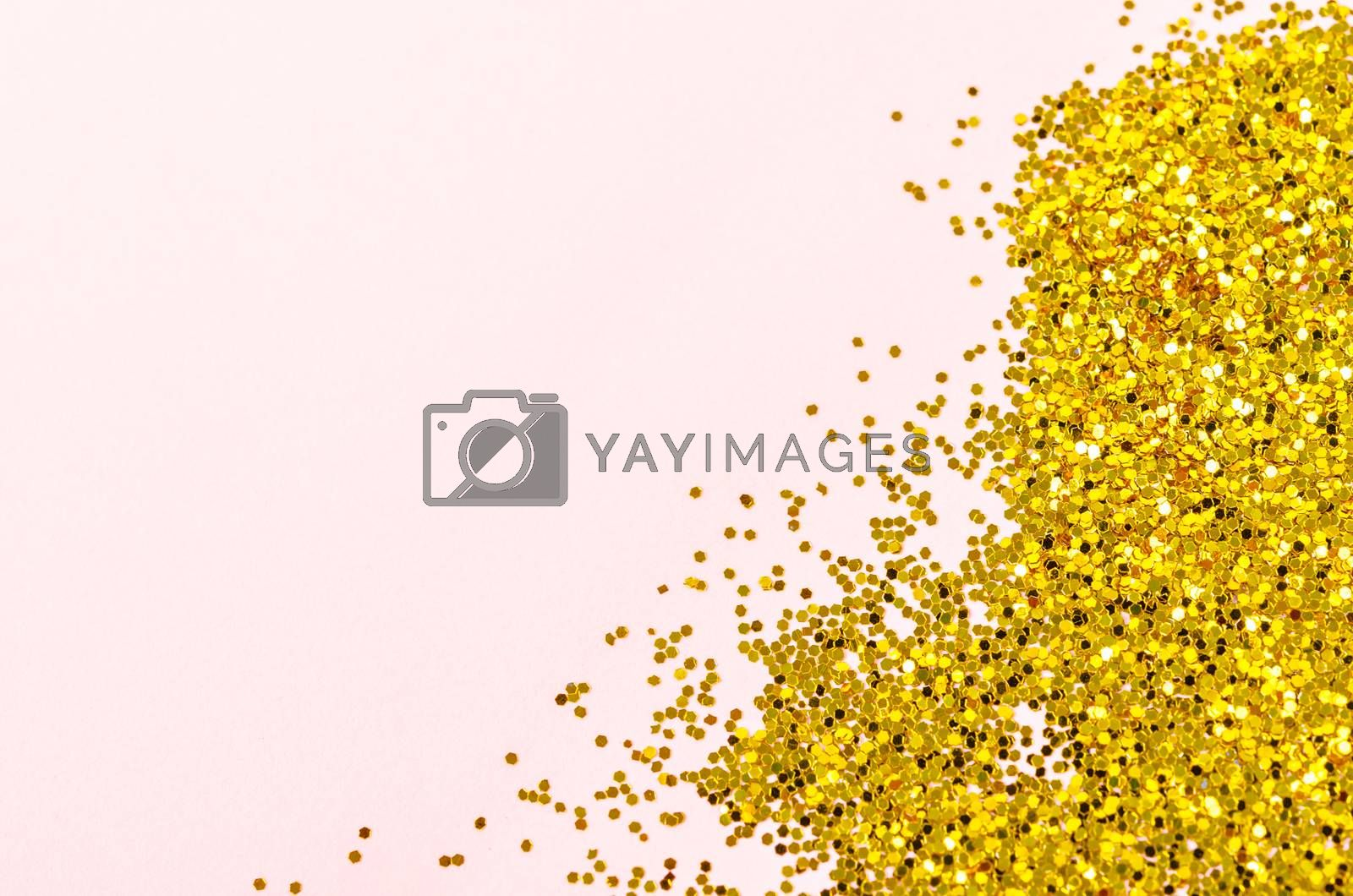 Small golden glitter on pink background with empty space for your text or message.