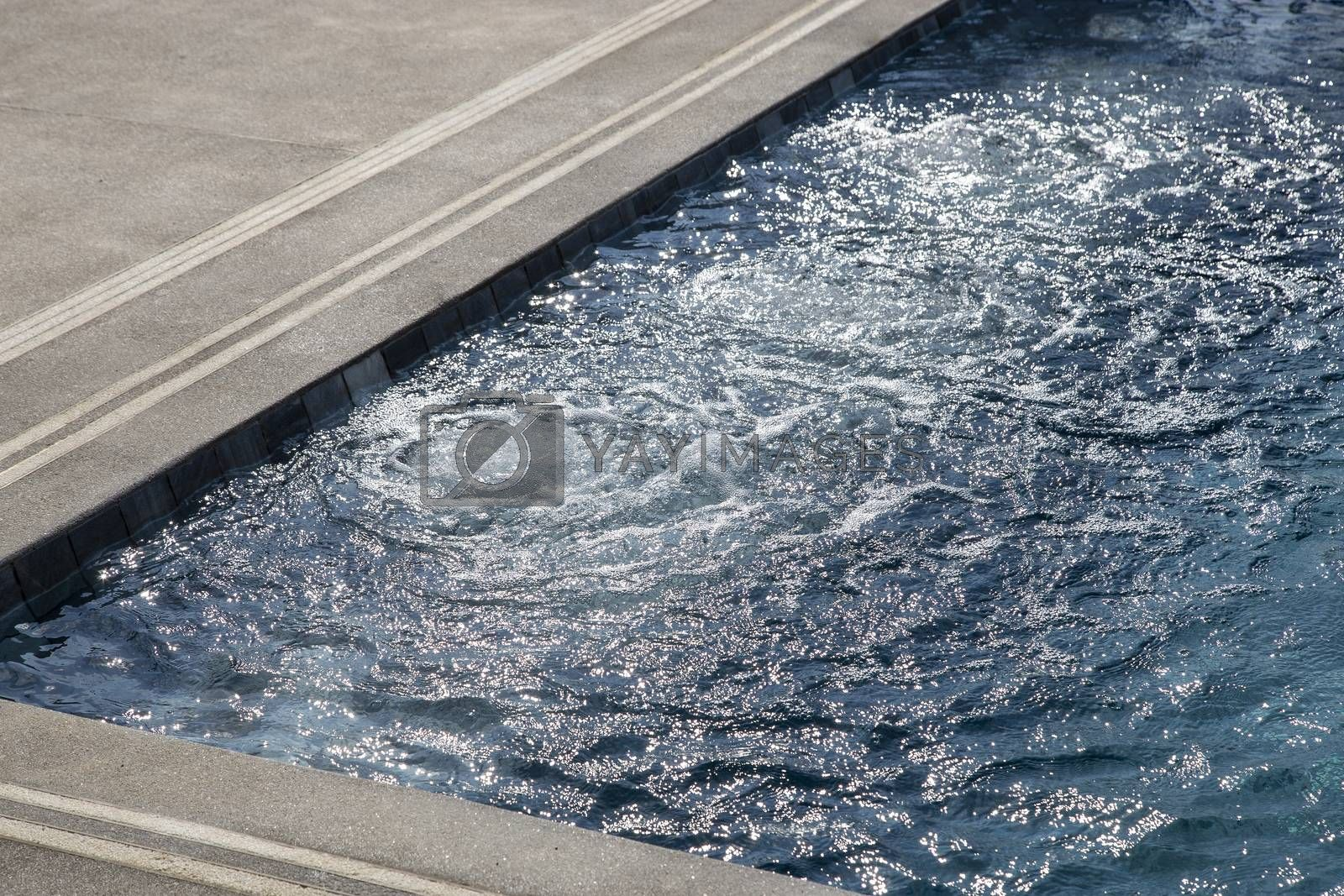 Air bubbles from working drain in swimming pool