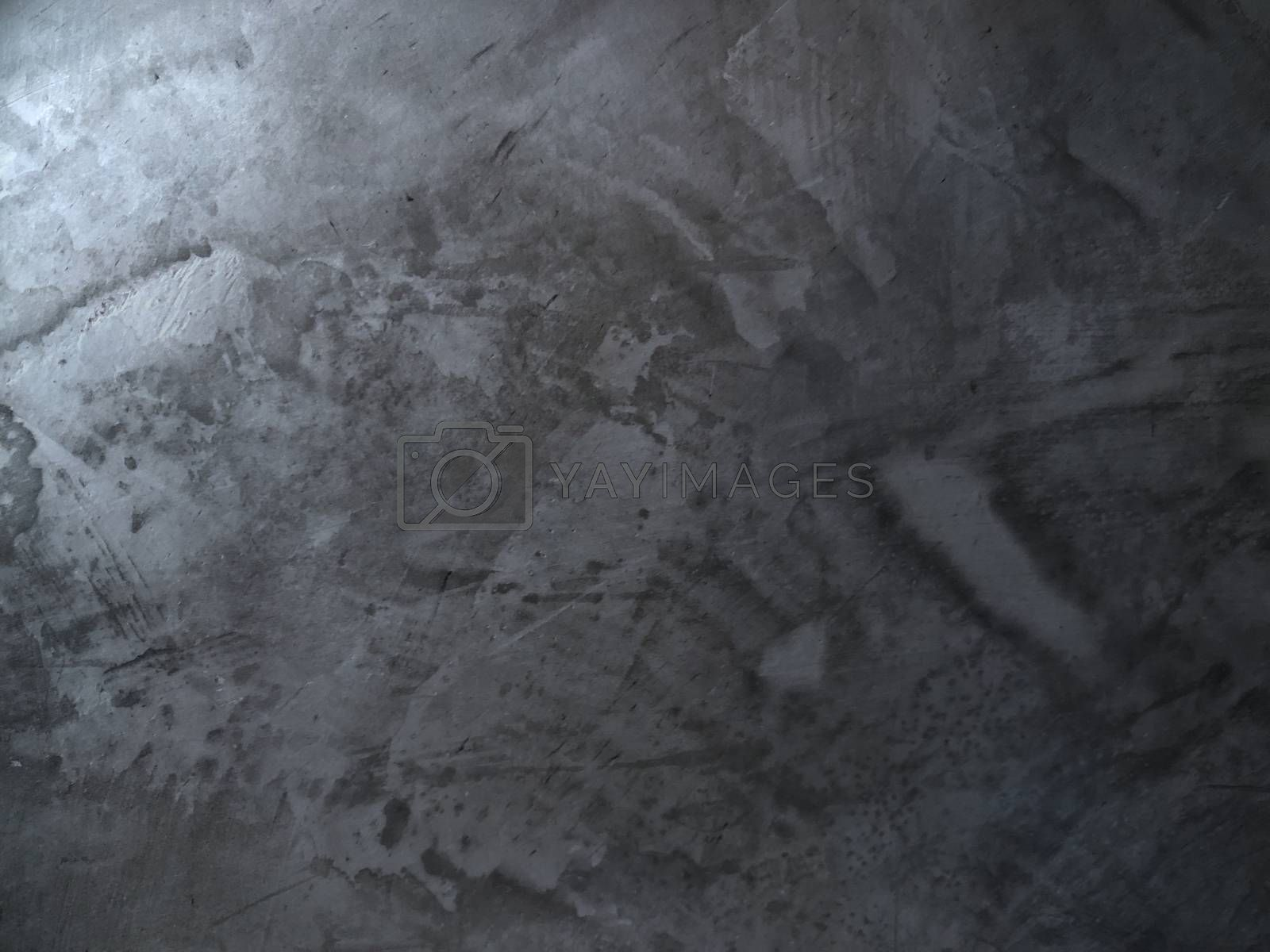 Abstract vintage scratched gray cement wall is a unique style of building structure.
