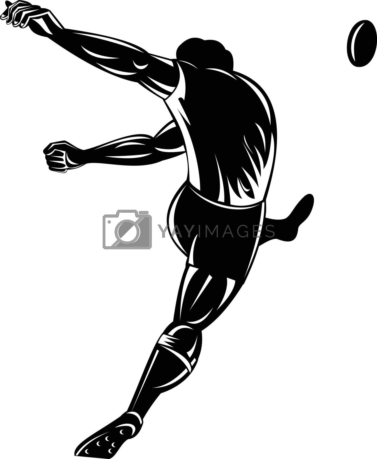 Retro woodcut style illustration of a rugby player or kicker kicking the ball viewed from rear or back  on isolated background done in black and white.