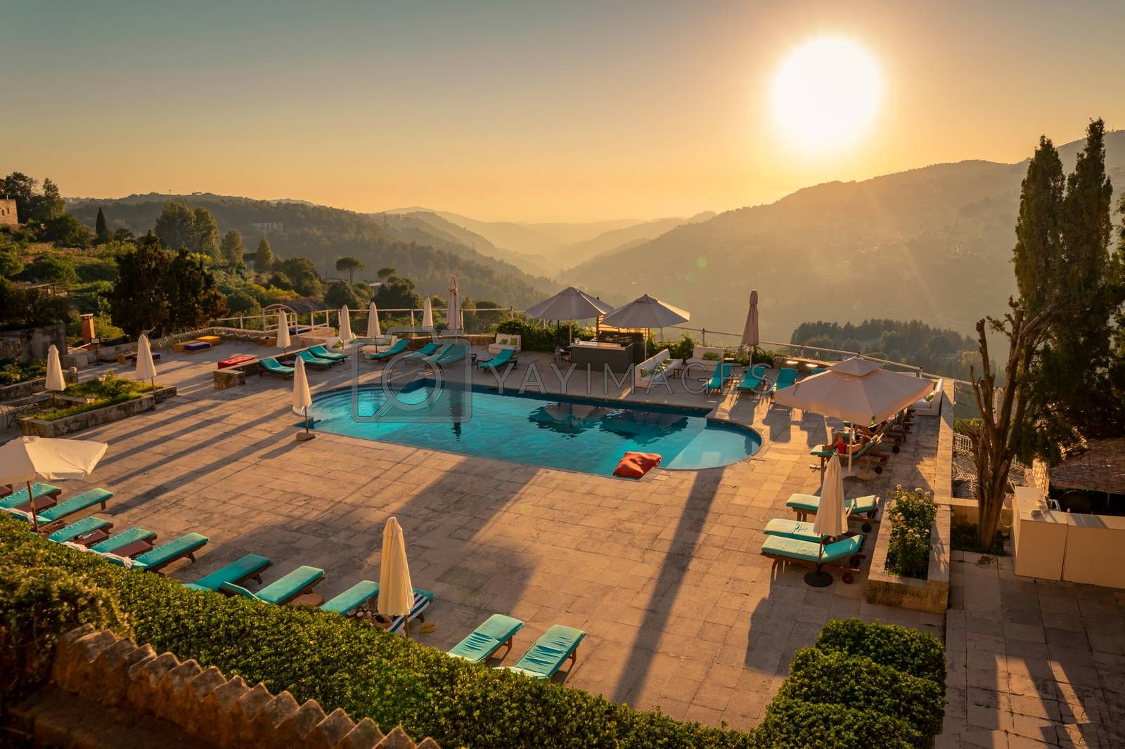 Traveling Lebanon. Pool with Refreshing Water in the Mild Sunset Light. Beautiful Resort in the Heart of the Mountains.